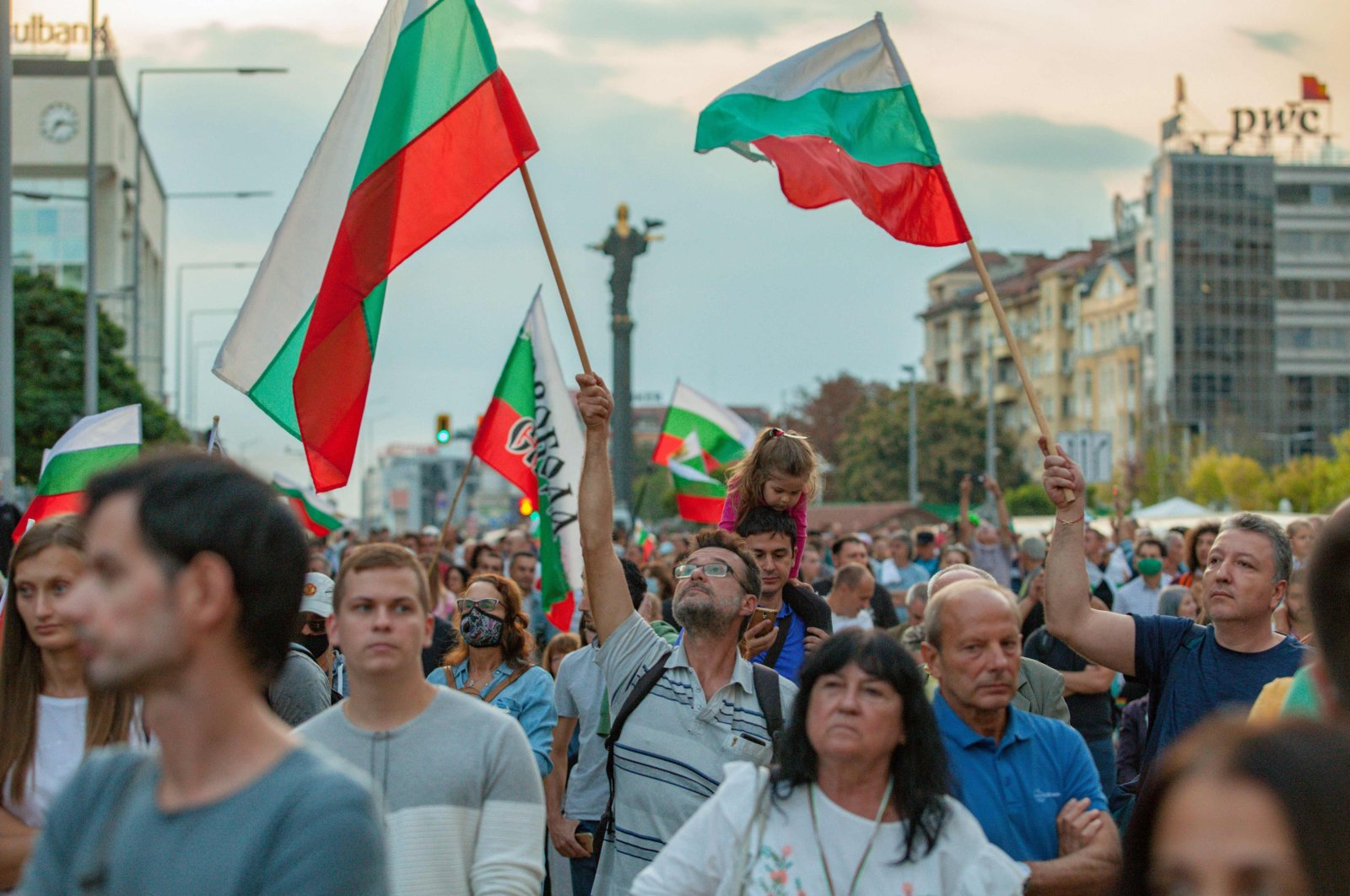 Protesters shout slogans and wave Bulgarian flags during a demonstration near the parliament building in Sofia, Bulgaria, Sept. 22, 2020. (AFP Photo)