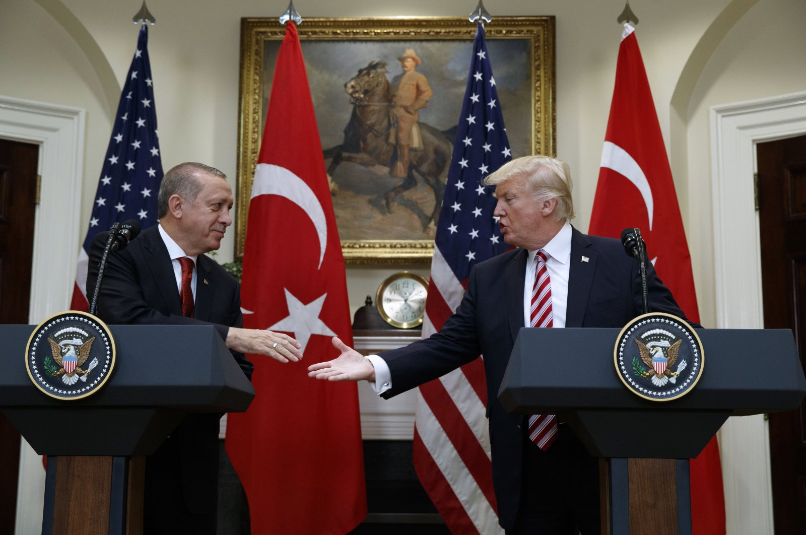 President Recep Tayyip Erdoğan shakes hands with U.S President Donald Trump in the Roosevelt Room of the White House, May 16, 2017, in Washington. (AP Photo)