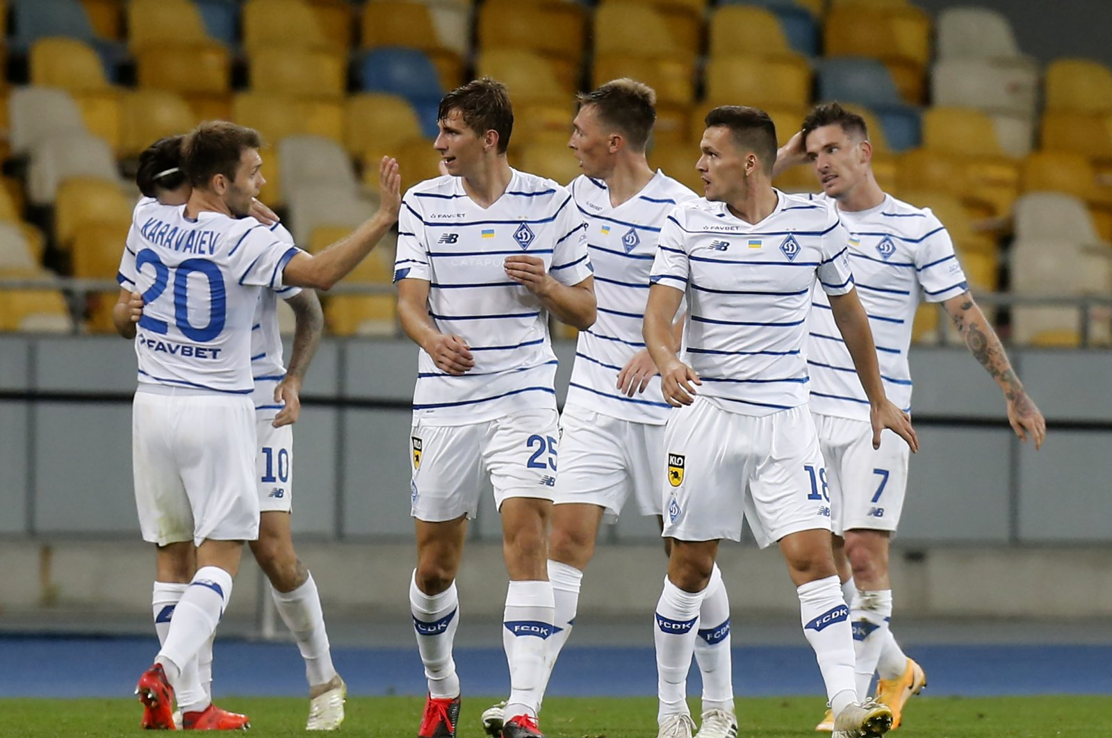 Dynamo Kyiv players celebrate after scoring their side's second goal during the Champions League third qualifying round match against AZ Alkmaar at the Olimpiyskiy Stadium in Kyiv, Ukraine, Sept. 15, 2020. (AP Photo)