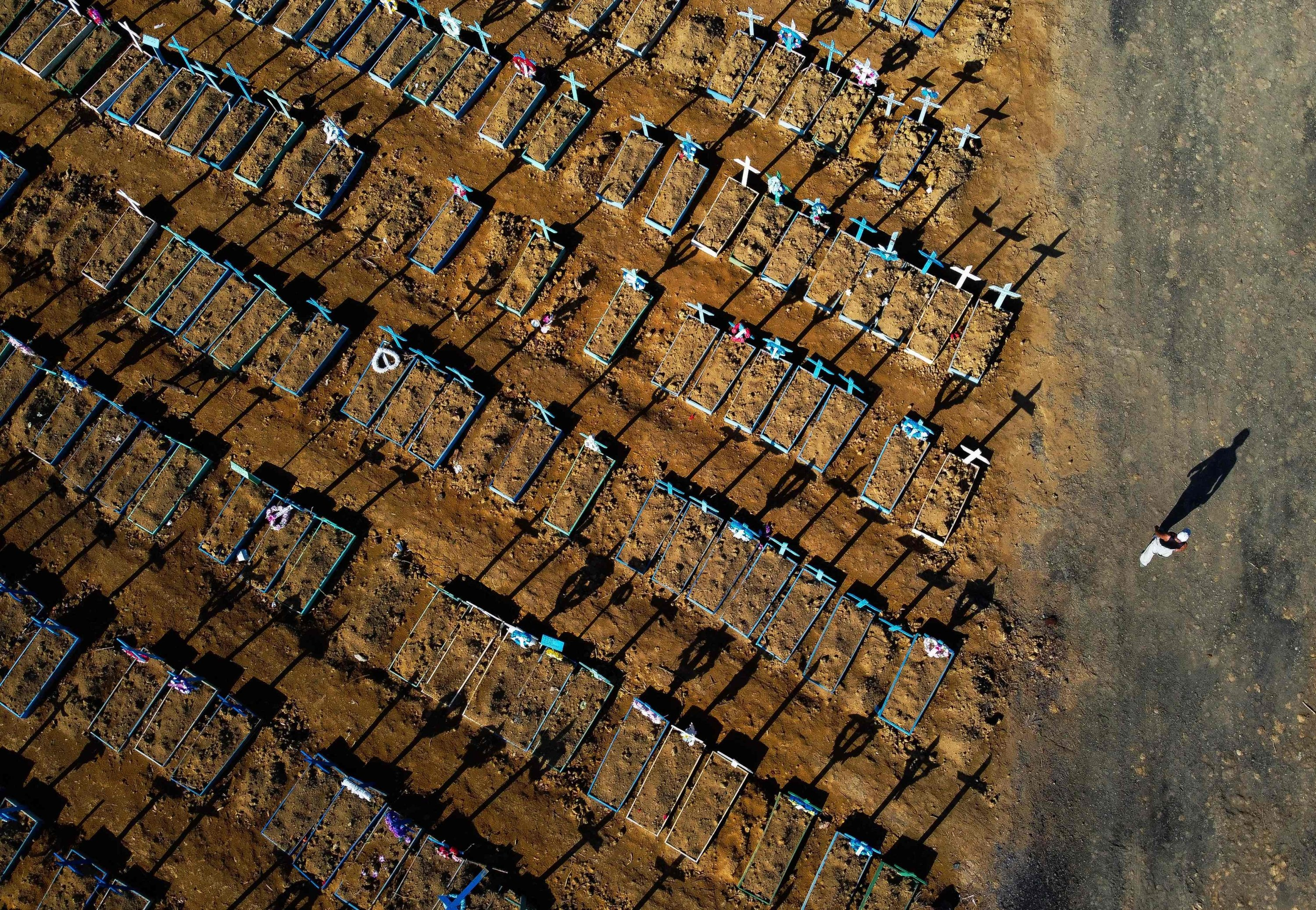 An aerial view of a man walking past graves in the Nossa Senhora Aparecida cemetery in Manaus, Brazil, June 21, 2020. (AFP Photo)