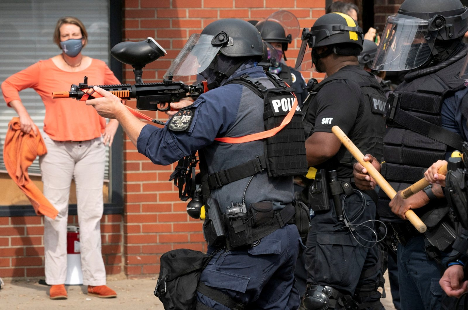 Police fire a pepper ball gun into a crowd during a protest in Louisville, Kentucky, U.S., Sept. 23, 2020. (REUTERS Photo)