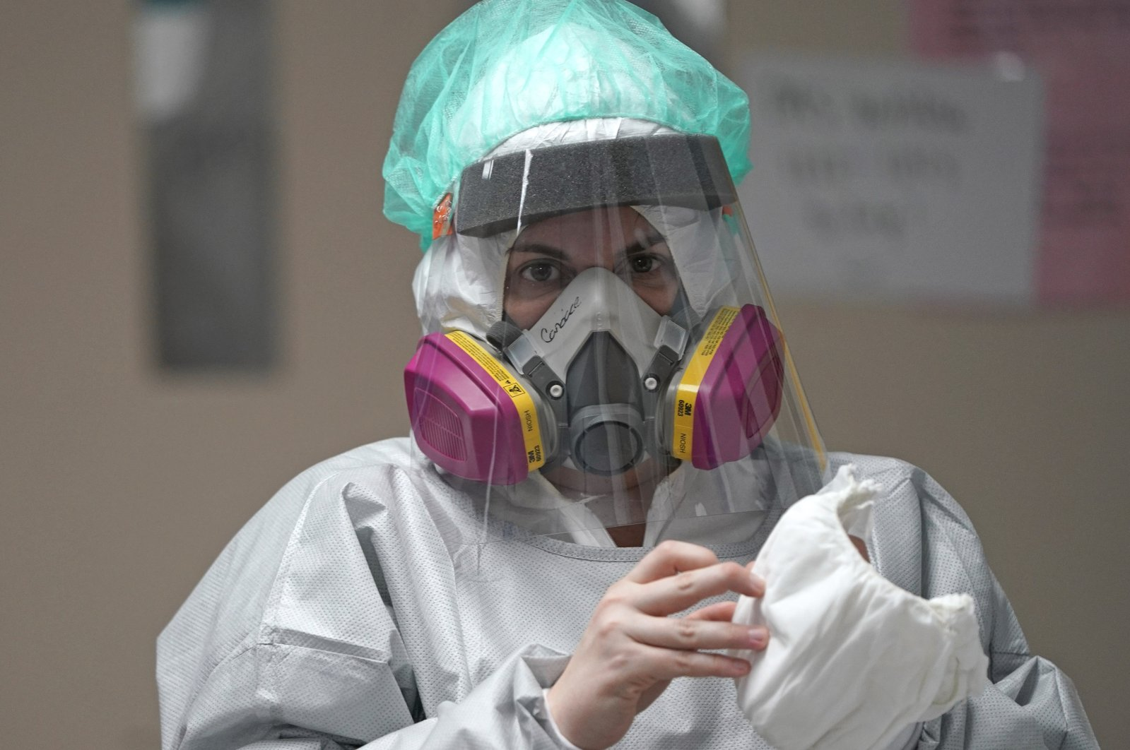 Registered nurse Candace Trammeor grabs shoe coverings inside the Coronavirus Unit at United Memorial Medical Center, Houston, Texas, U.S., July 6, 2020. (AP Photo)