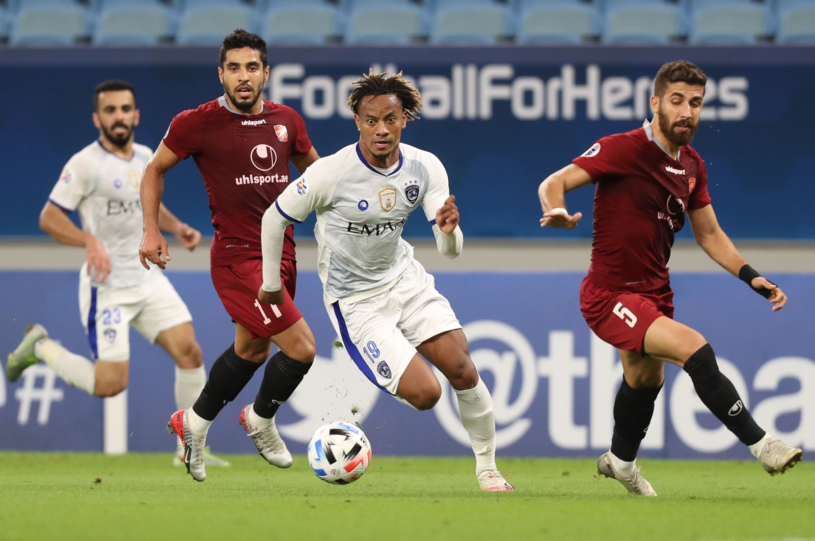 Al-Hilal's Andre Carrillo (C) in action against Shahr Khdro players, in Al Wakrah, Qatar, Sept. 20, 2020. (AFP Photo)