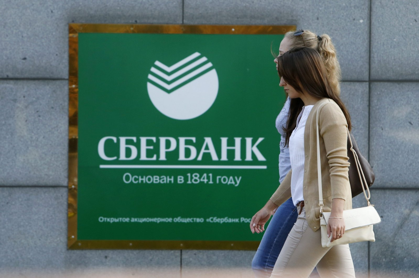 Women walk past an office of Sberbank in Moscow, Russia on Sept. 12, 2014. (Reuters Photo)