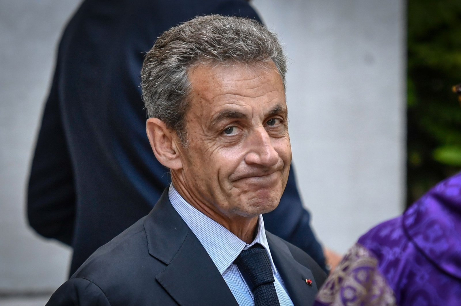 Former French President Nicolas Sarkozy leaves the mass for the funeral of late French Justice Minister Pascal Clement at Saint Peter's Church in Neuilly-sur-Seine, France, June 25, 2020. (AFP Photo)