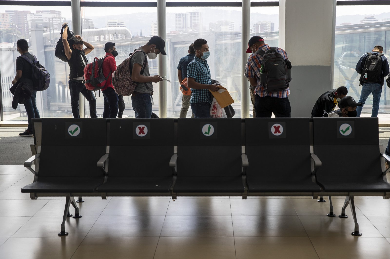 Passengers wait to board a humanitarian flight to Canada at the La Aurora international airport in Guatemala City, Sept. 17, 2020. (AP Photo)