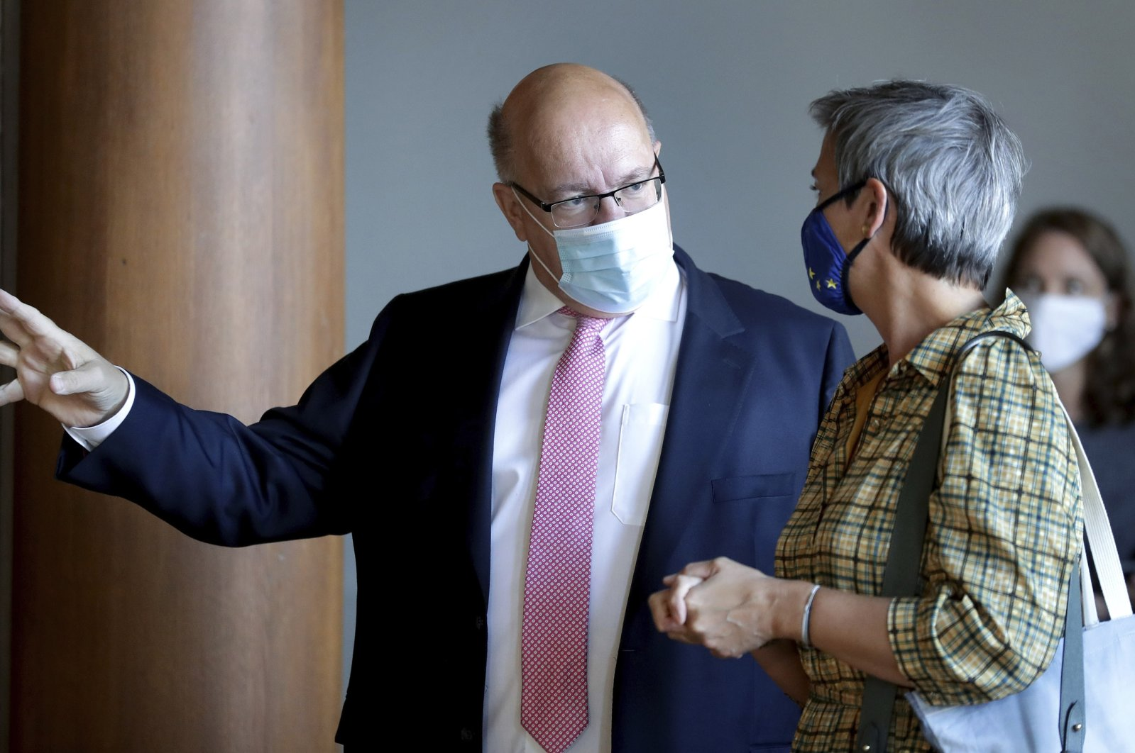 """German Economy Minister Peter Altmaier (L) gestures as he welcomes Executive Vice-President of the European Commission Margrethe Vestager (R) for the """"European Competition Day"""" at the German Economy Ministry in Berlin, Germany, Sept. 7, 2020. (AP Photo)"""