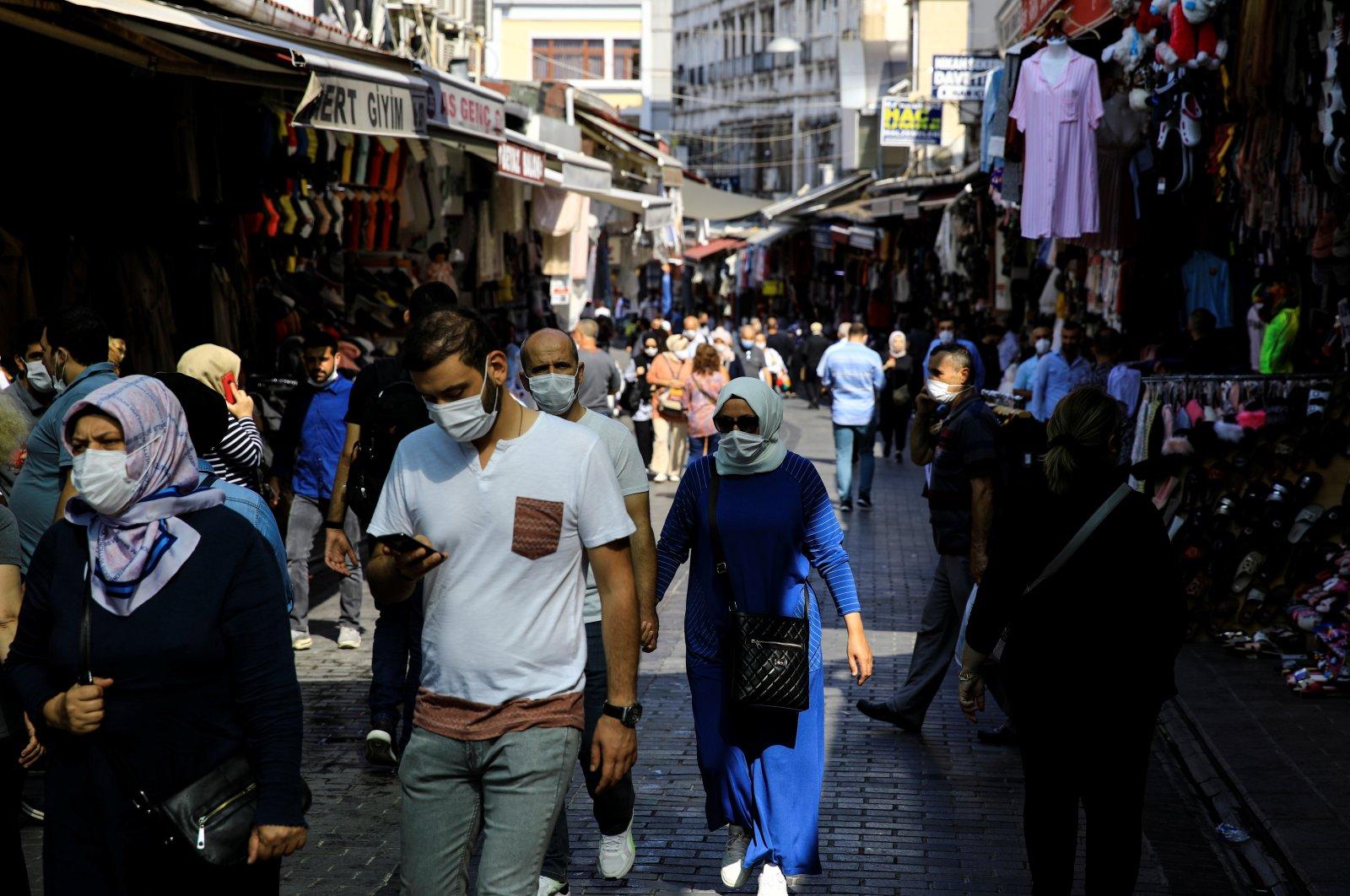 People wearing masks walk on a street in Eminönü district, in Istanbul, Turkey, Sept. 24, 2020. (REUTERS Photo)