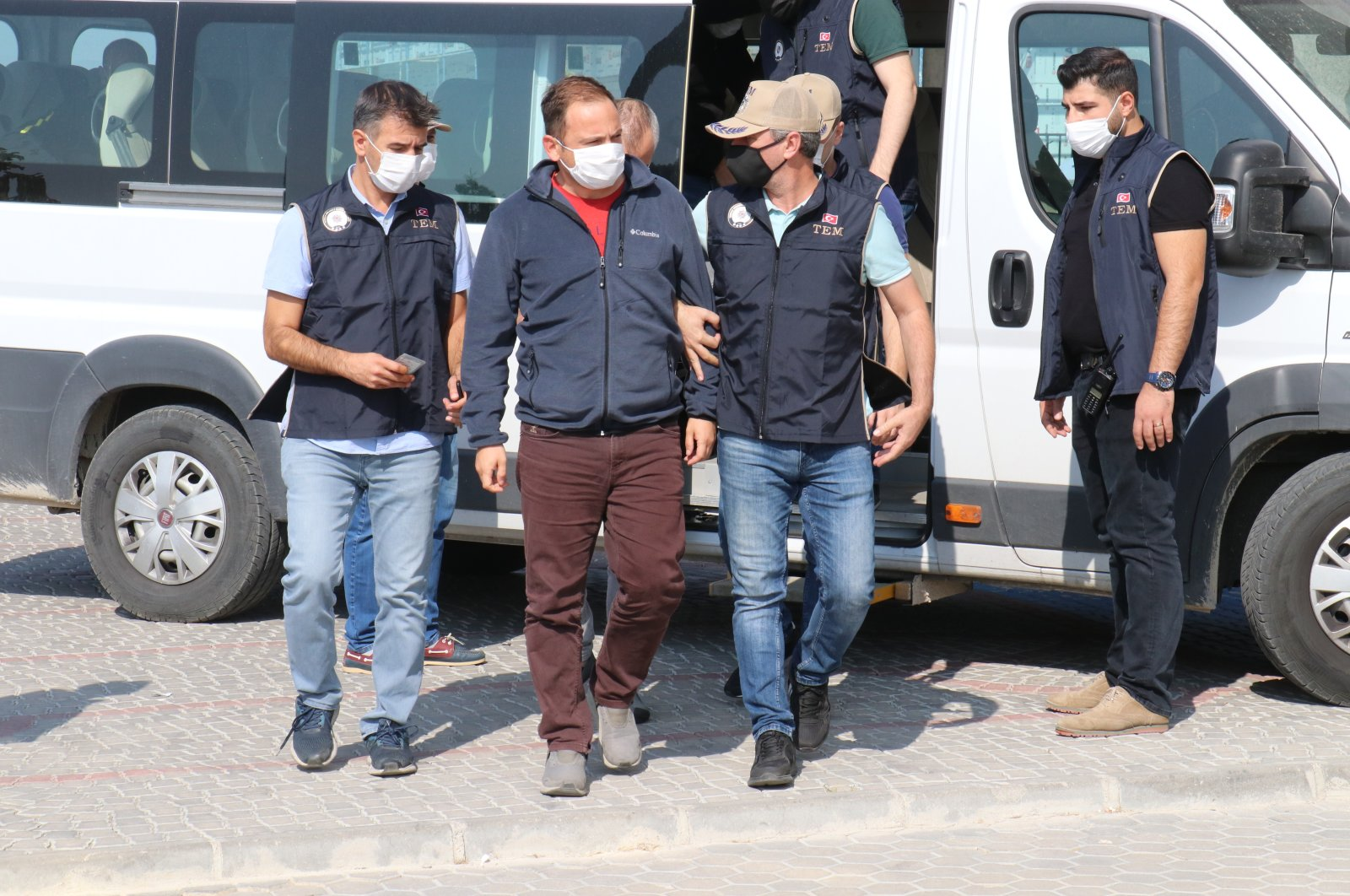 Police escort captured FETÖ suspects to the courthouse, in Kırklareli, northwestern Turkey, Sept. 24, 2020. (AA Photo)