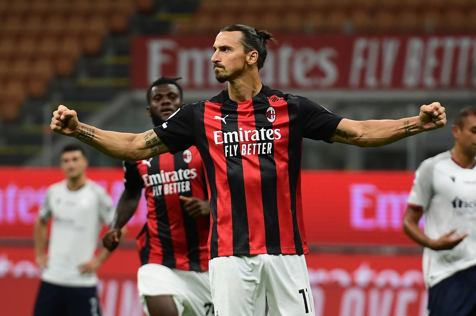 Zlatan Ibrahimovic celebrates after scoring a goal against Bologne, in Milan, Italy, Sept. 21, 2020. (AFP Photo)