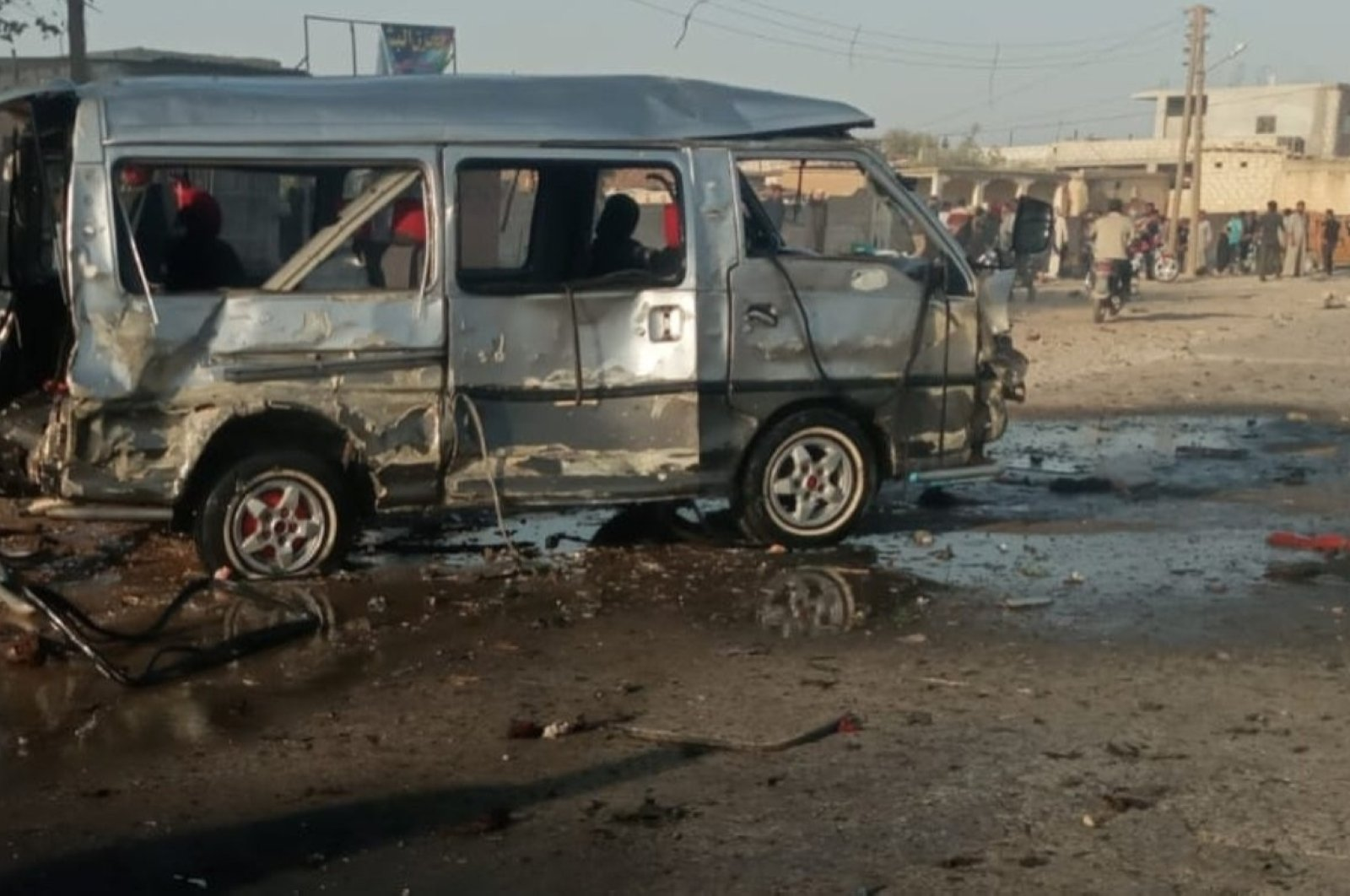 The remains of a bomb-laden vehicle that exploded in northern Syria's Ras al-Ain, killing two and injuring 11, are seen on Sept. 24, 2020. (IHA Photo)