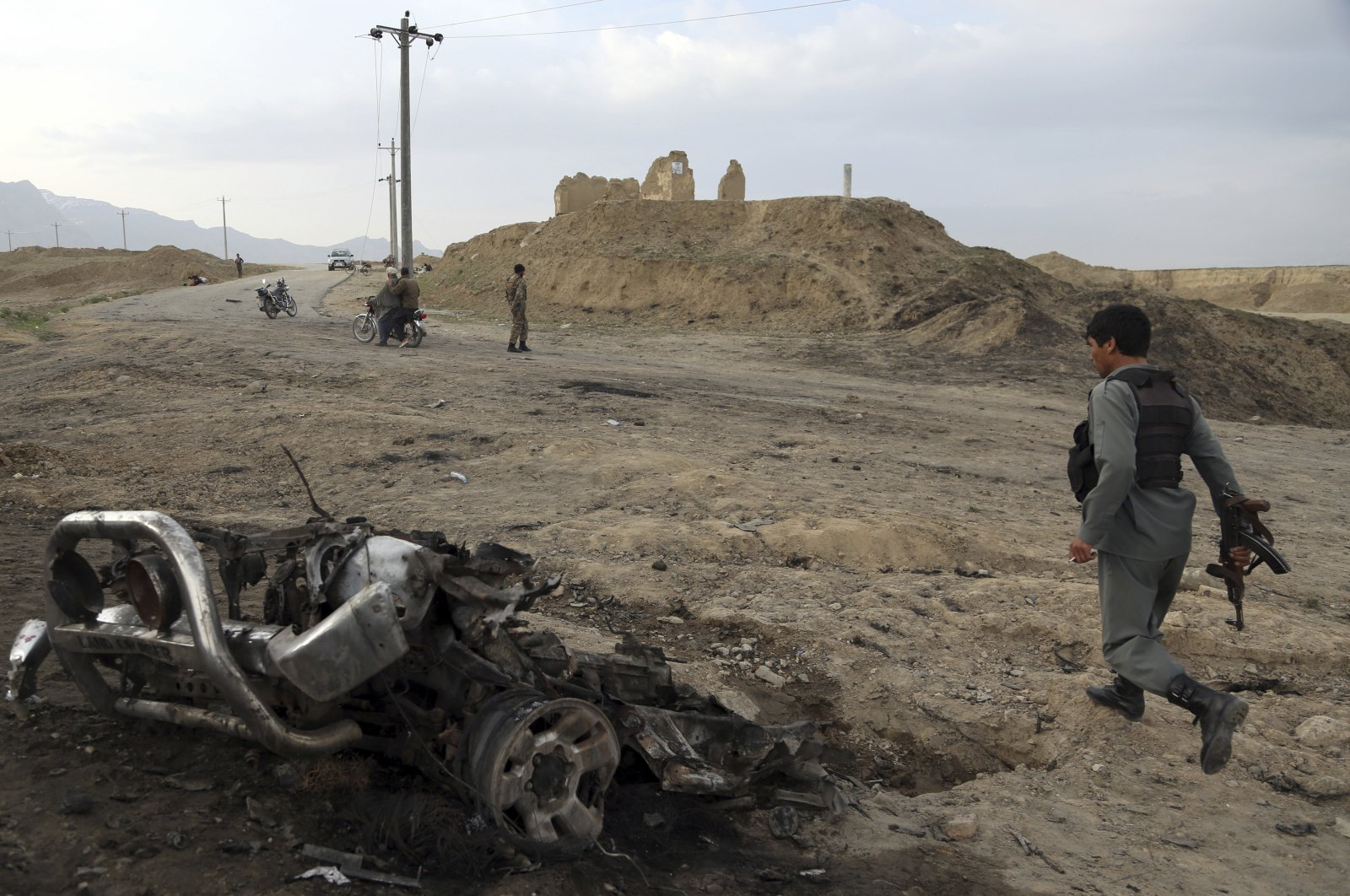In this file photo, Afghan security forces gather at the site of an attack near Bagram air base, north of Kabul, Afghanistan, April 9, 2019. (AP Photo)