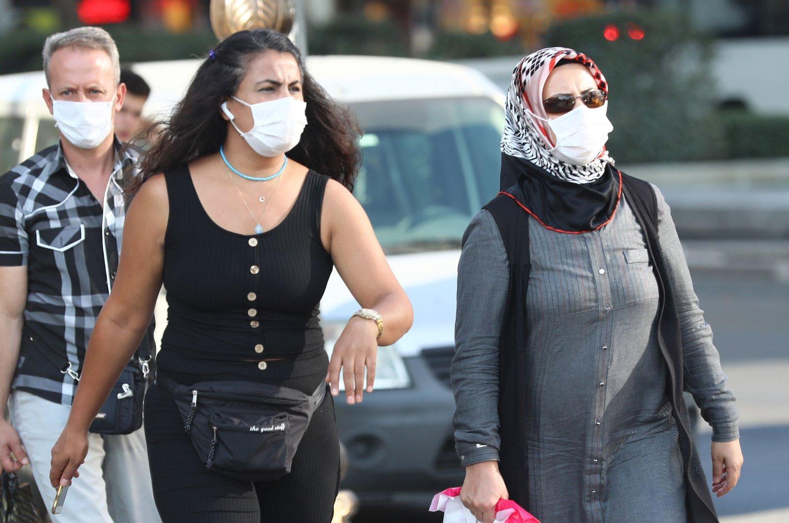 People wearing masks walk along a street in the capital Ankara, Turkey, Sept. 18, 2020. (AFP Photo)