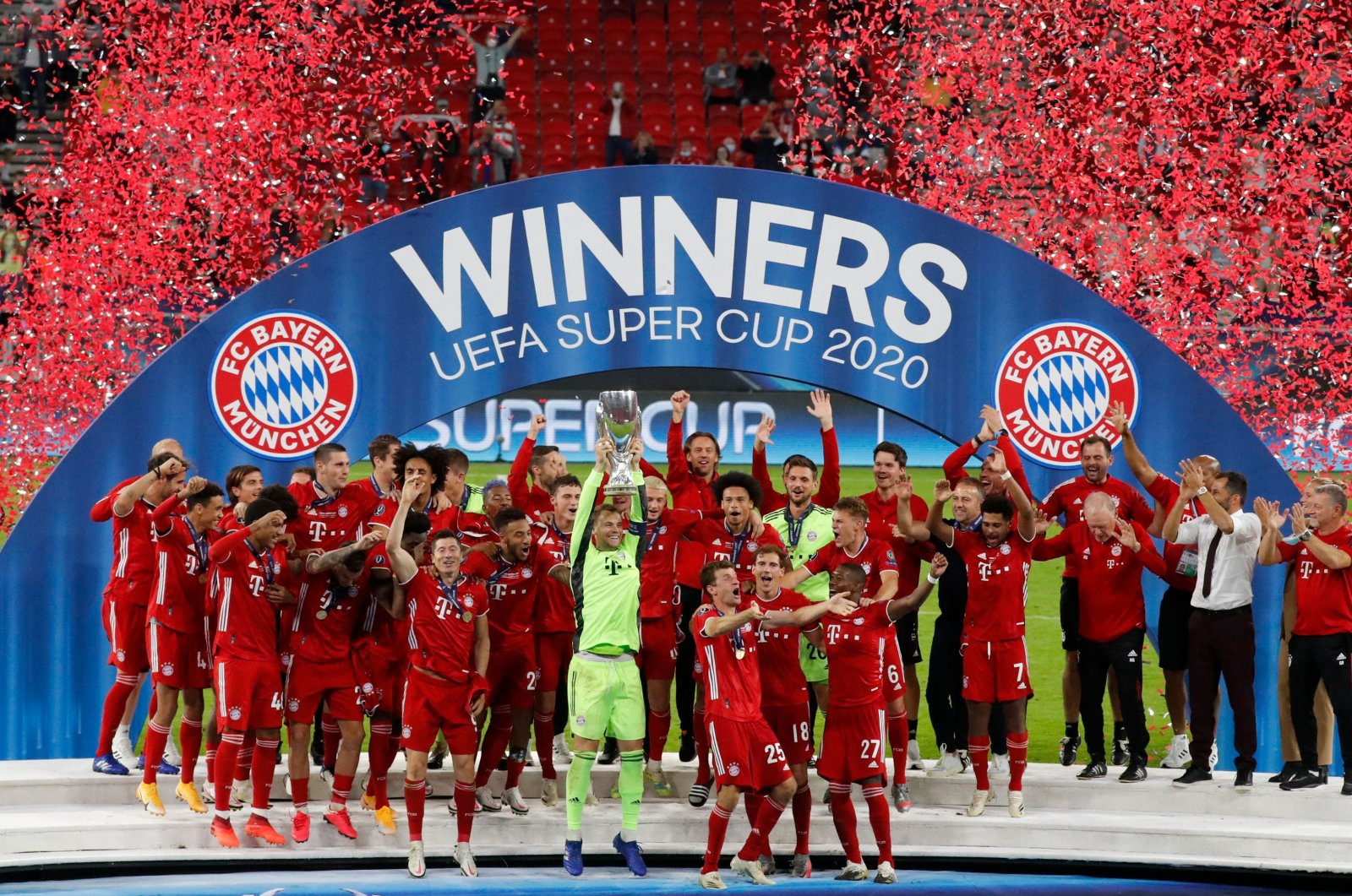 Bayern Munich's Manuel Neuer lifts the trophy with his teammates as they celebrate after winning the UEFA Super Cup match against Sevilla, in Budapest, Hungary, Sept. 24, 2020. (AFP Photo)
