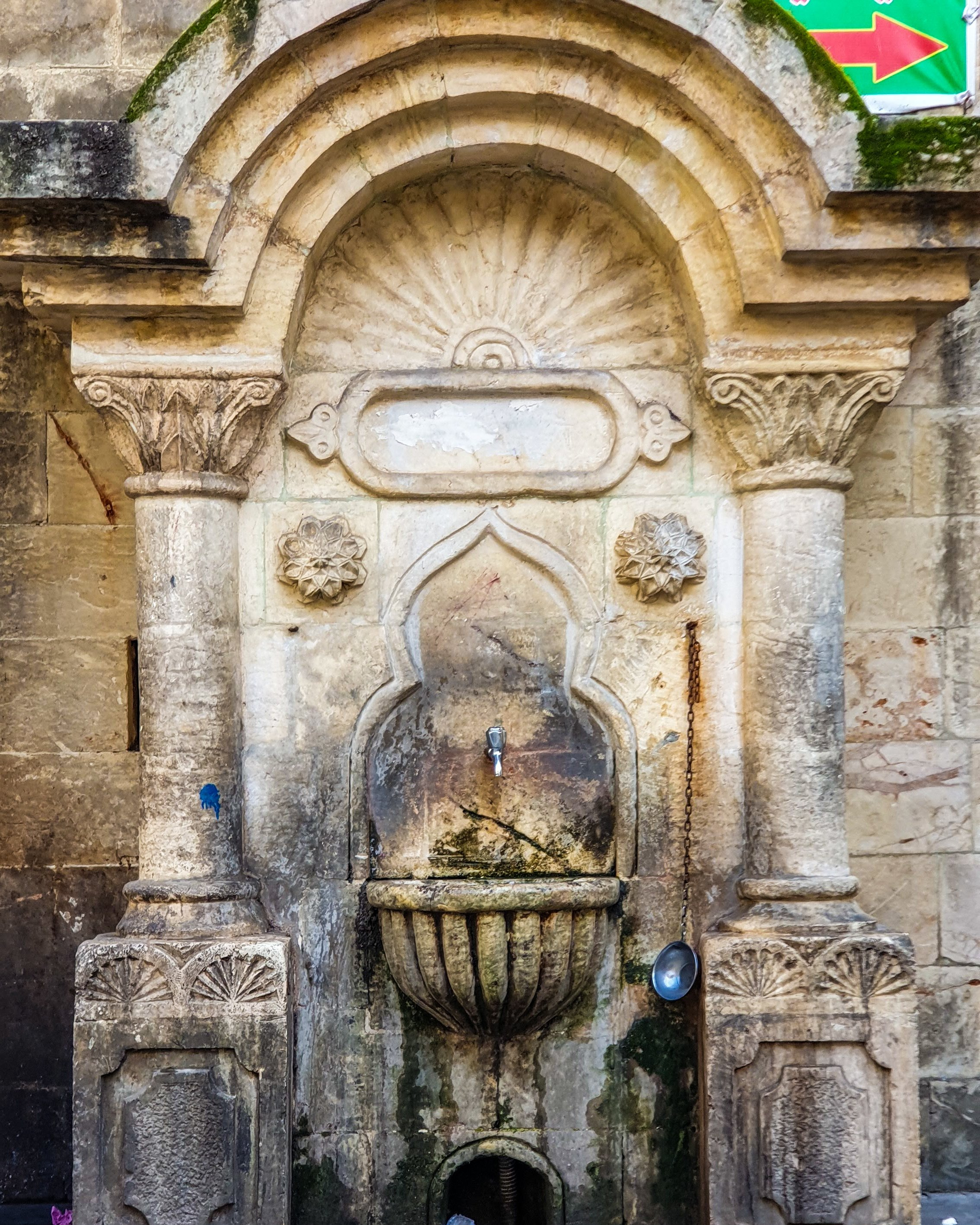 A historic fountain in the back alleys of the covered bazaar. (Photo by Argun Konuk)
