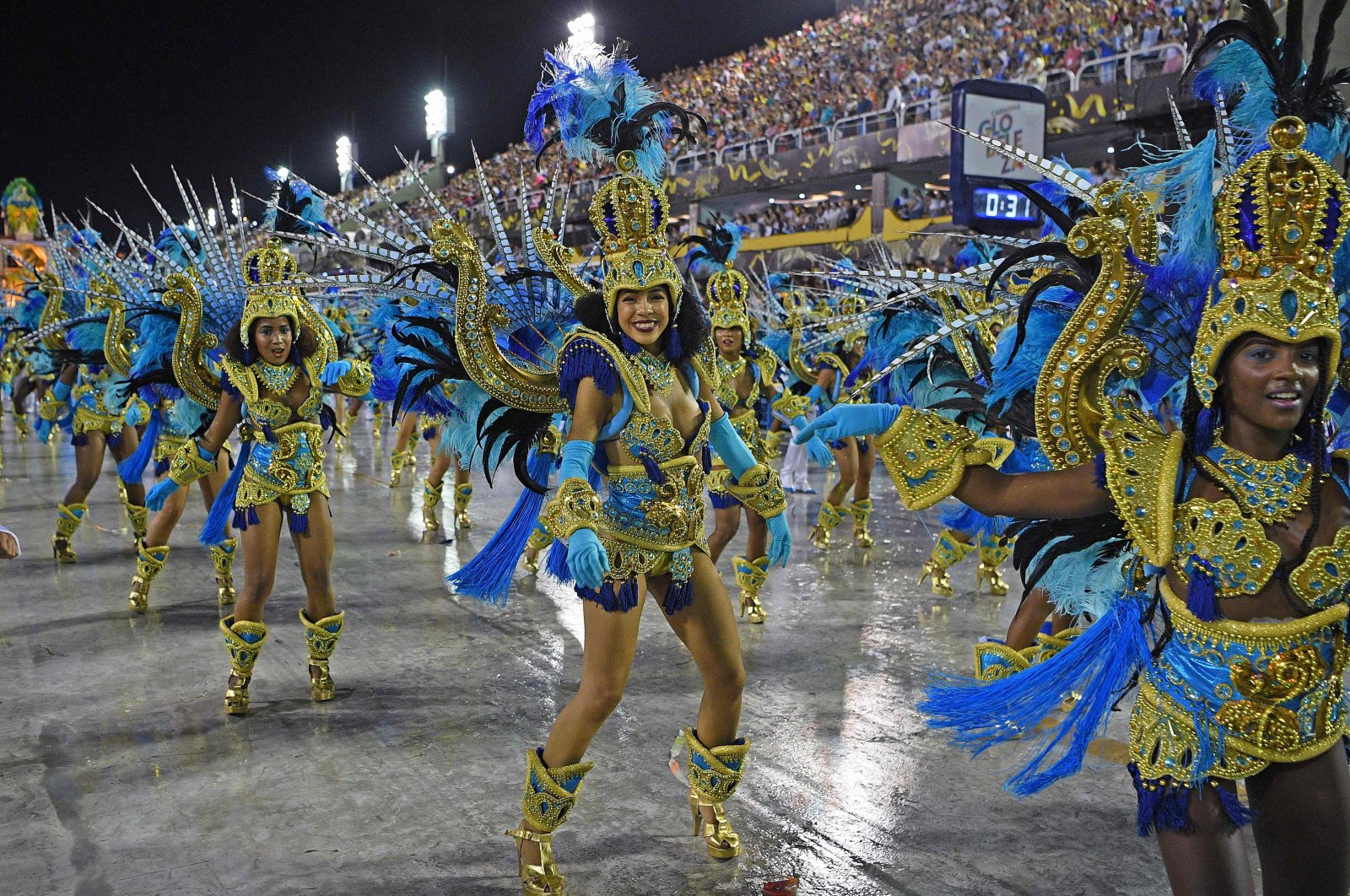 Members of Vila Isabel samba school perform during the last night of Rio's Carnival parade at the Sambadrome Marques de Sapucai in Rio de Janeiro, Brazil, Feb, 24, 2020. (AFP Photo)