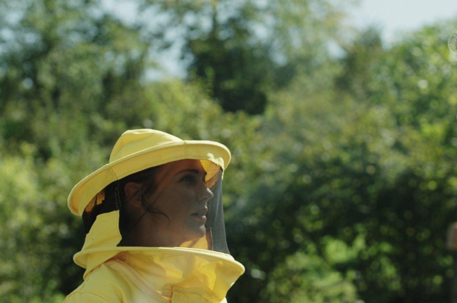 """Actress Meryem Uzerli in the role of a beekeeper in """"Kovan."""""""
