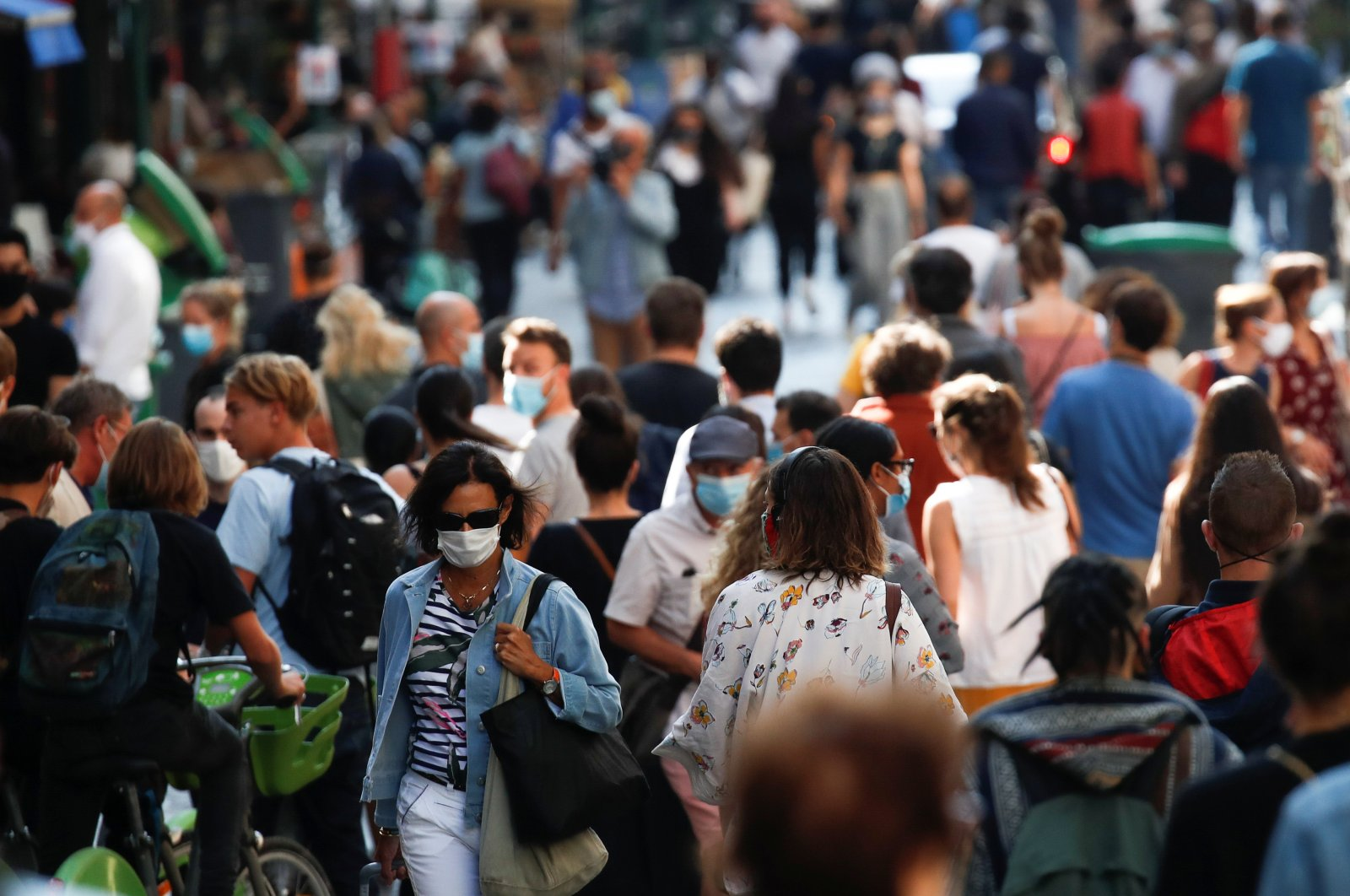 People wearing protective face masks walk in a busy street, Paris, France, Sept. 18, 2020. (Reuters Photo)