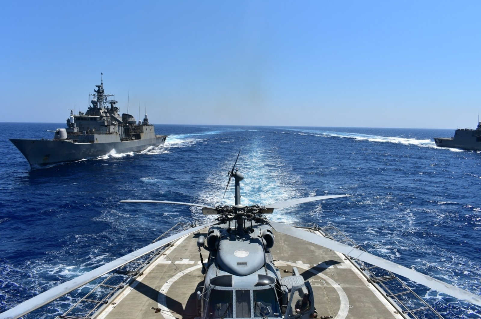 In this photo provided by the Greek Defense Ministry, warships take part in a military exercise in the Eastern Mediterranean, Aug. 25, 2020. (AP Photo)