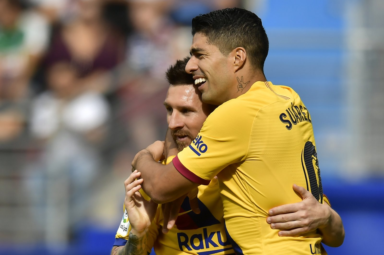 Barcelona's Luis Suarez (R) celebrates a goal with Lionel Messi during a La Liga match against Eibar, in Eibar, Spain, Oct. 19, 2019. (AP Photo)