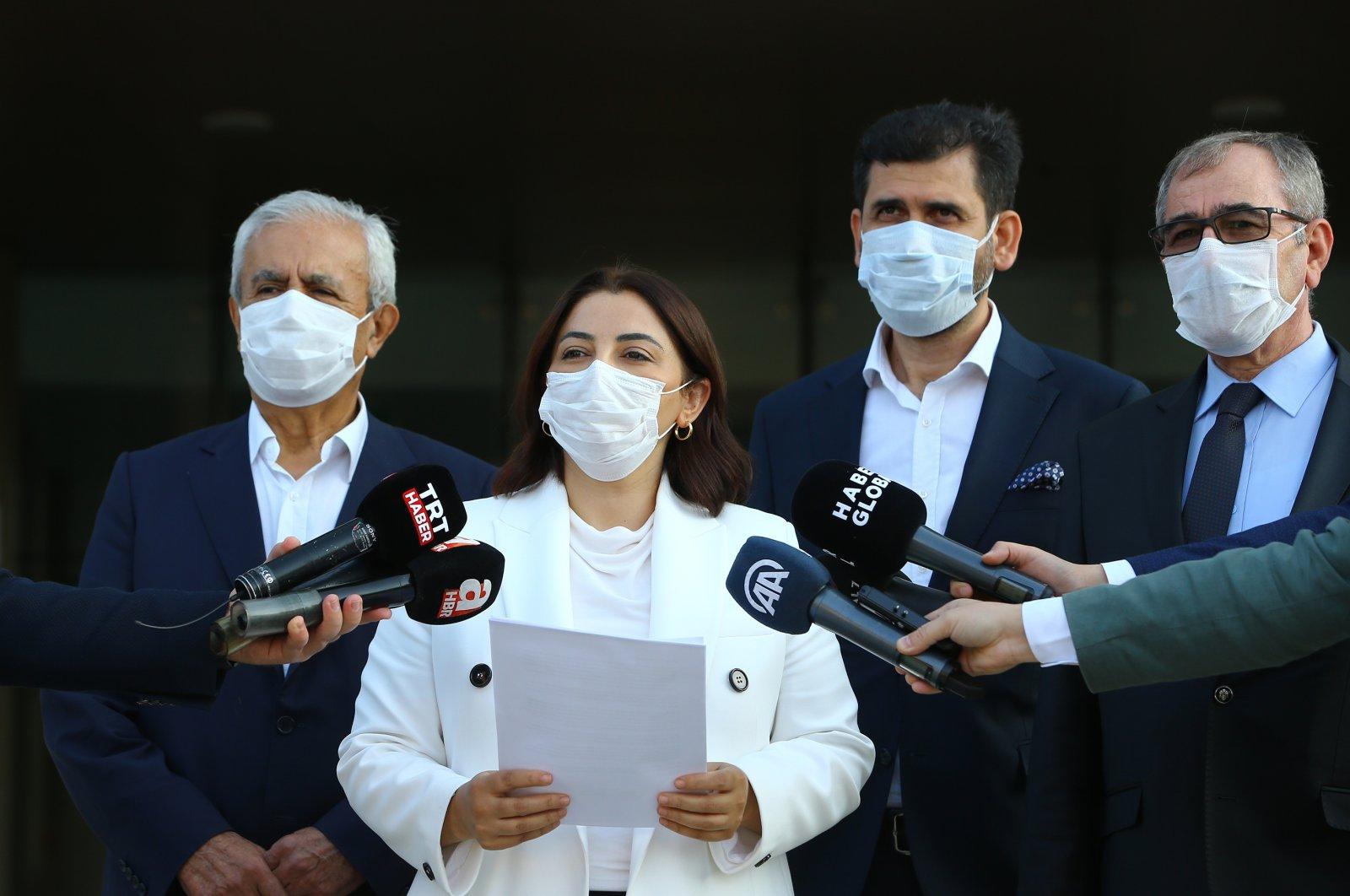 Lawyers (from L to R) Necati Ceylan, Şengül Karslı, Niyazi Paksoy and Cavit Tatlı speak at a press conference in front of the Union of Turkish Bar Associations' (TBB) headquarters in Ankara, Sept. 25, 2020. (AA Photo)