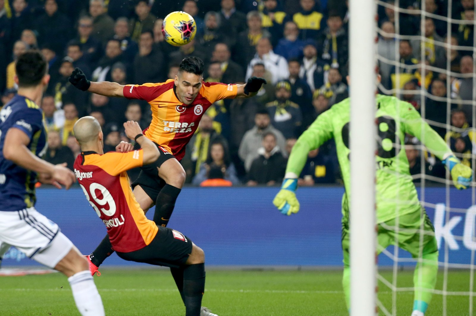 Galatasaray's Radamel Falcao (C) goes for a header during a Süper Lig derby match against Fenerbahçe, in Istanbul, Turkey, Feb. 23, 2020. (AA Photo)