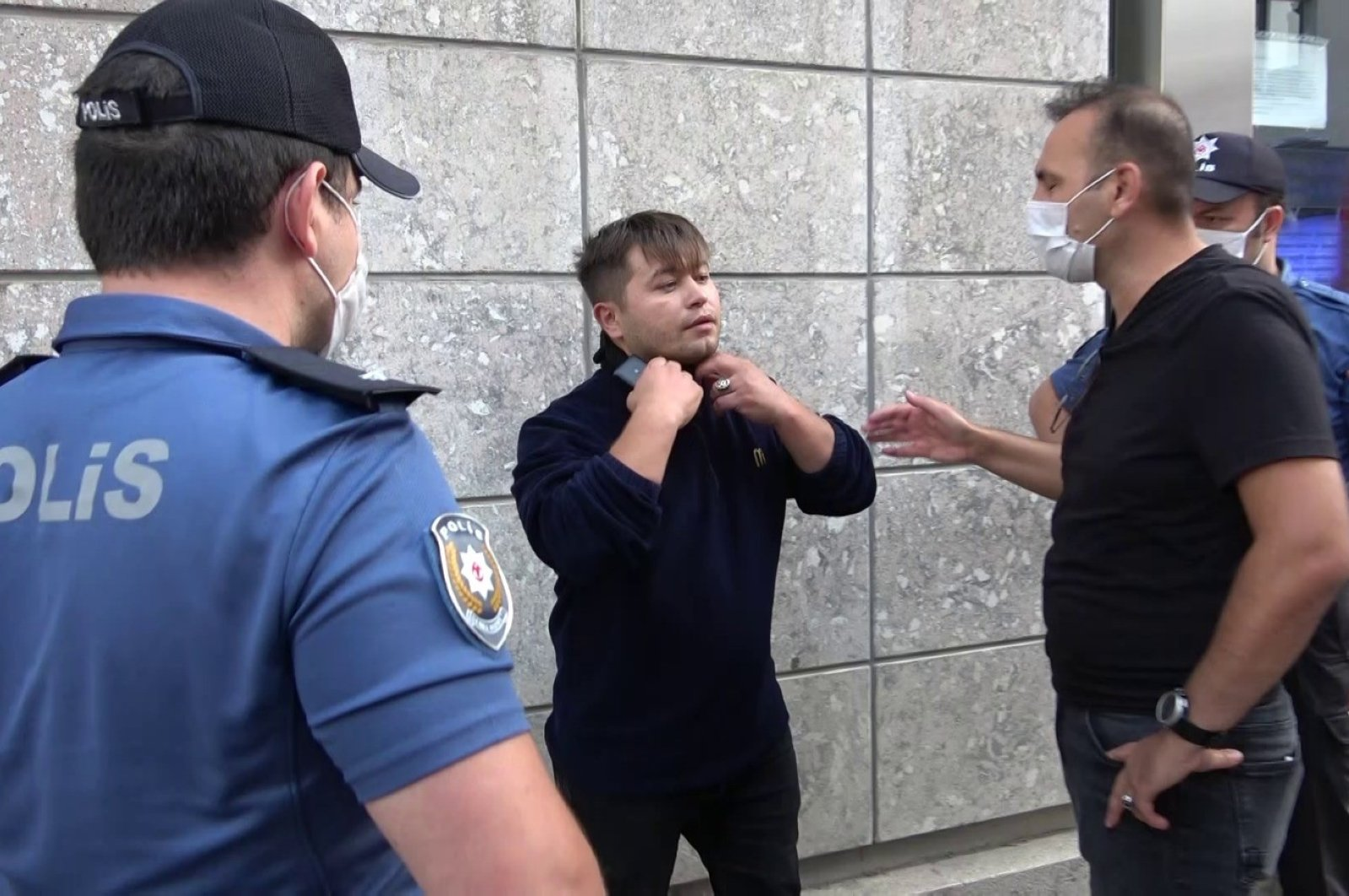Police officers confront a man not wearing a face mask during an inspection in Istanbul, Turkey, Sept. 23, 2020. (IHA Photo)