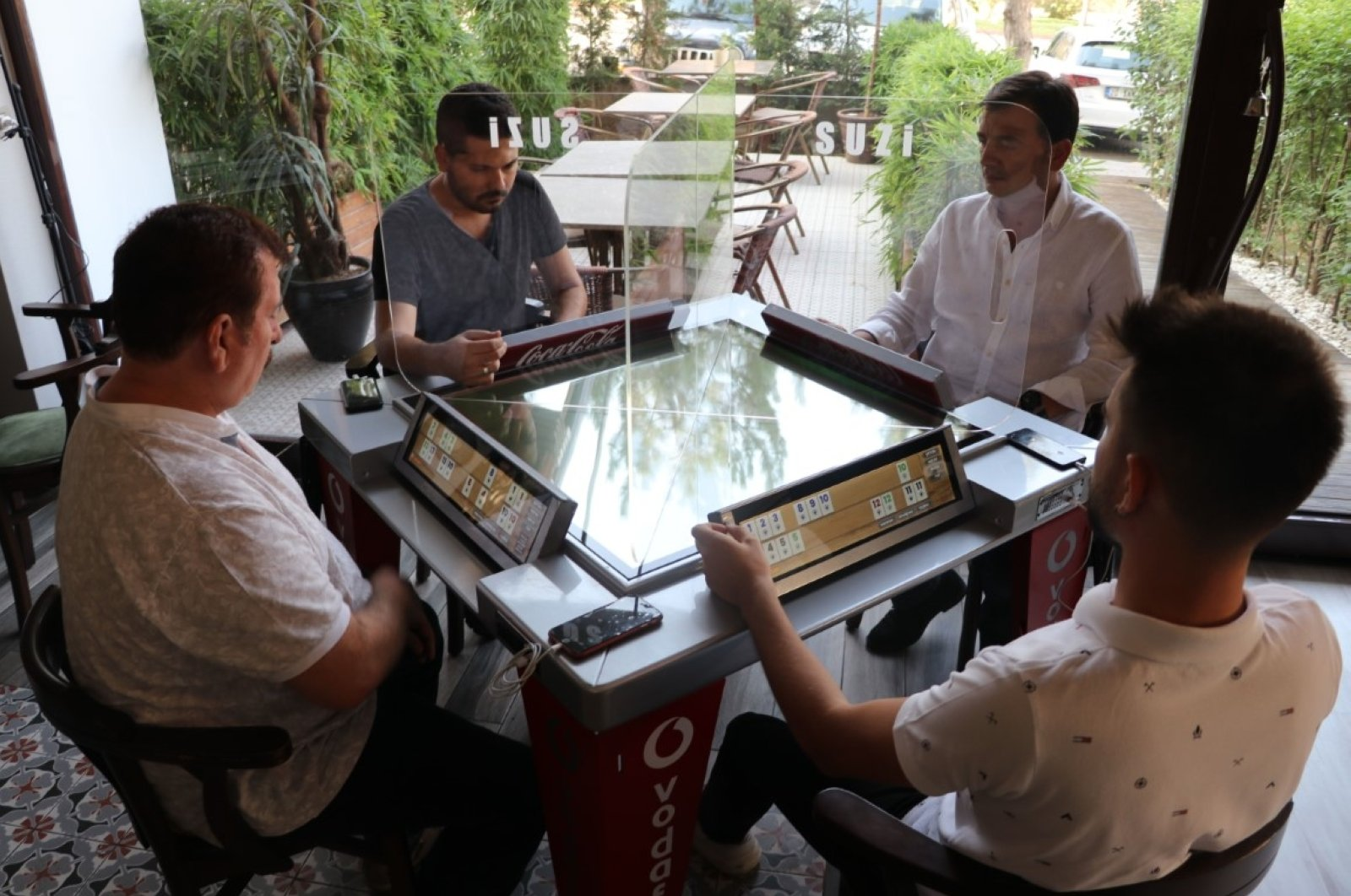 People play okey at the digital table, in Denizli, western Turkey, Sept. 23, 2020. (DHA Photo)