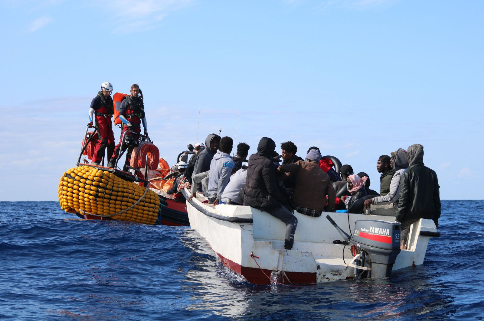 SOS Mediterranee team members from the humanitarian ship Ocean Viking approach a boat in distress with 30 people on board in the Mediterranean waters off Libya, Nov. 20, 2019. (AP Photo)