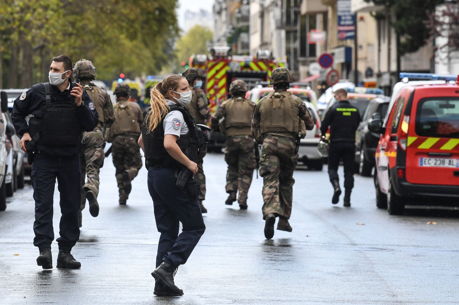 French army soldiers rush to the scene after several people were injured near the former offices of the French satirical magazine Charlie Hebdo following an alleged attack by a man wielding a knife in the capital Paris on September 25, 2020. (AFP Photo)