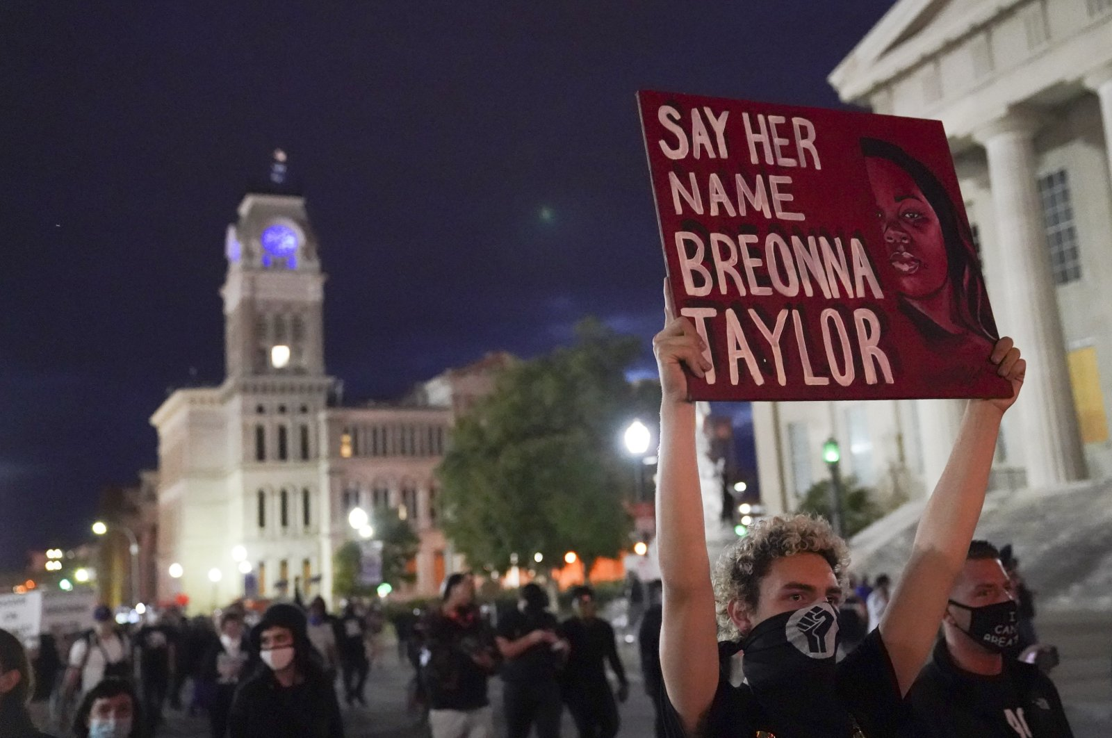 Protesters march following the decision not to charge police officers for killing Breonna Taylor, Sept. 24, 2020, in Louisville, Kentucky. (AP Photo)