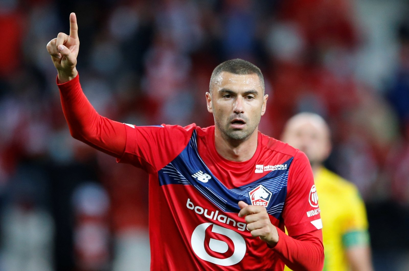 Lille's Turkish forward Burak Yılmaz celebrates scoring a goal during a Ligue 1 football match between Lille and Nantes at Stade Pierre-Mauroy, Lille, France, Sept. 25, 2020. (Reuters Photo)