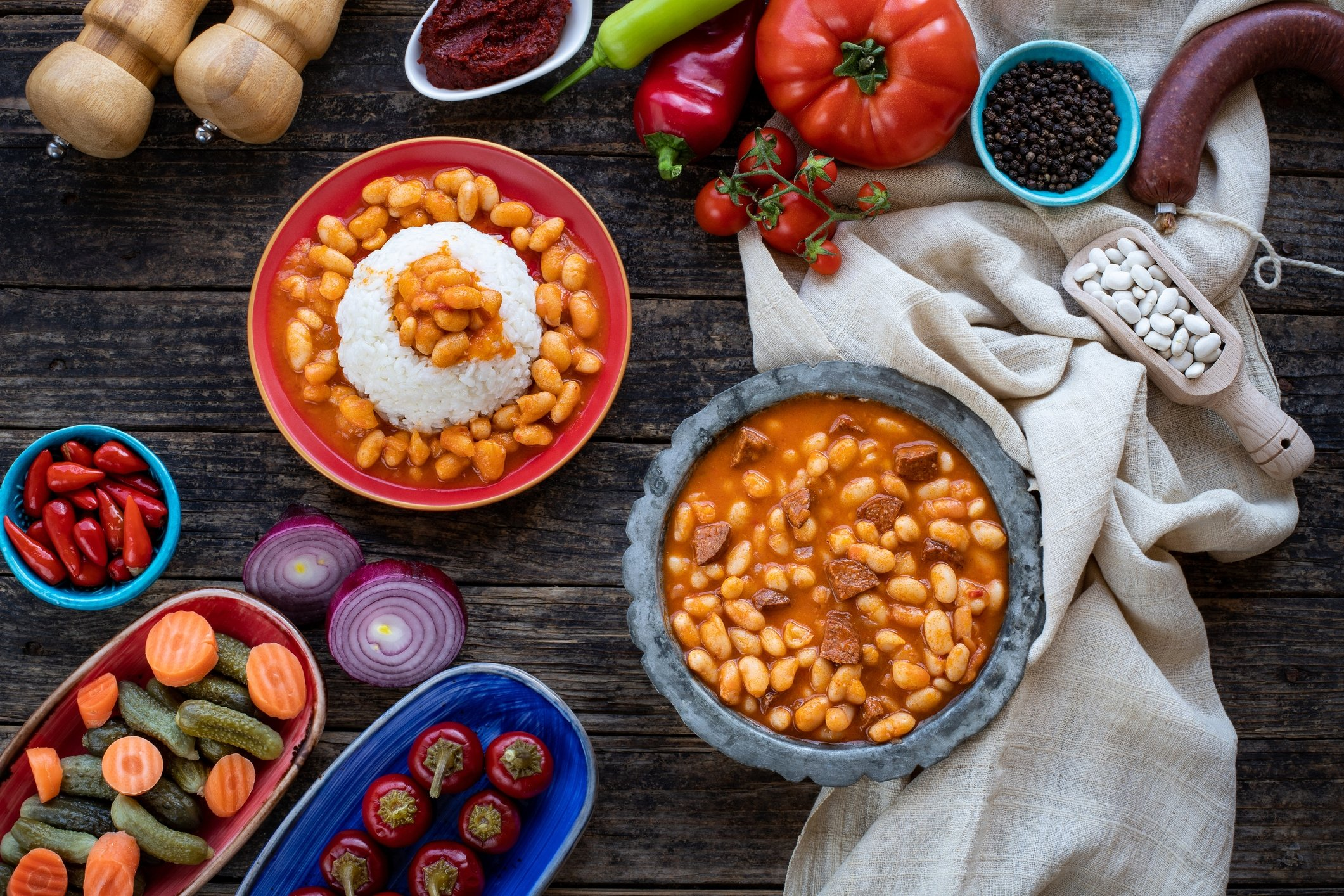 Kuru fasulye, a traditional Turkish bean dish, is often served with onion and variety of pickles. (iStock Photo)