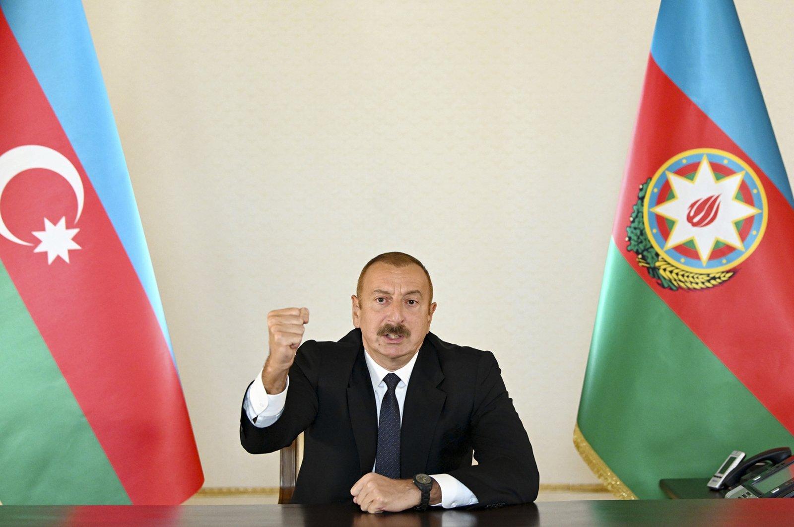 Azerbaijani President Ilham Aliyev gestures as he addresses the nation in Baku, Azerbaijan, Sept. 27, 2020. (Azerbaijani Presidential Press Office via AP)