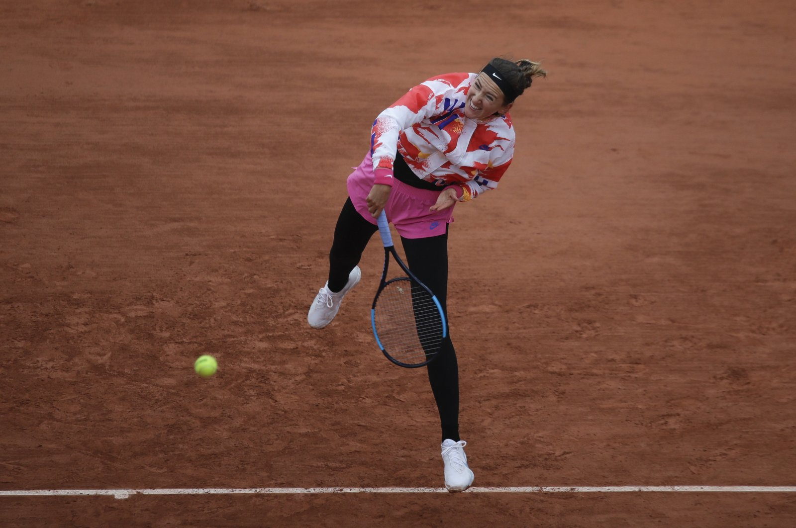 Victoria Azarenka serves in a match against Danka Kovinic, in Paris, France, Sept. 27, 2020. (AP Photo)