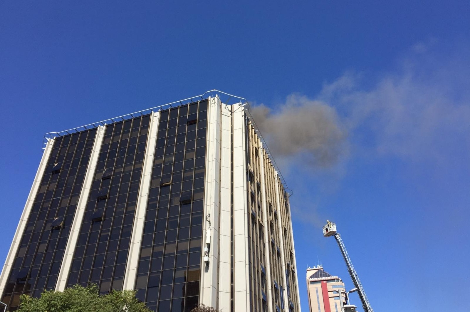 Smoke billows over the building in Beşiktaş district, Istanbul, Turkey, Sept. 27, 2020. (AA Photo)