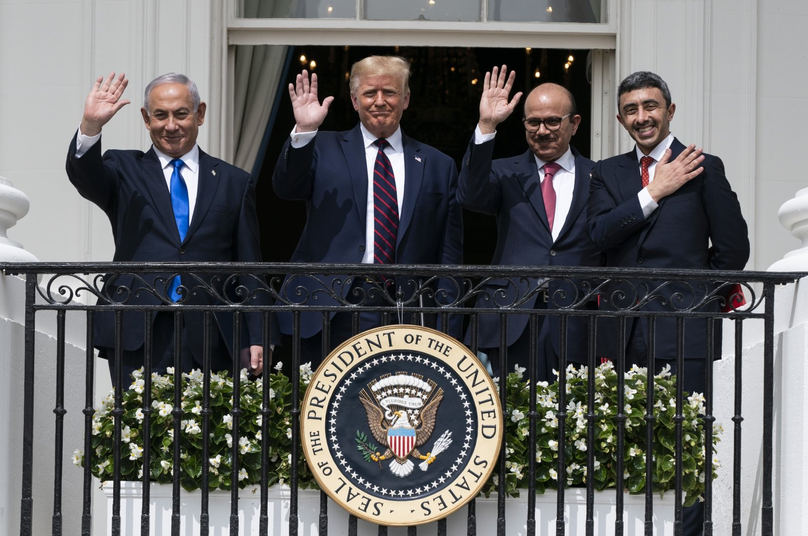 (From L to R) Israeli Prime Minister Benjamin Netanyahu, U.S. President Donald Trump, Bahrain Foreign Minister Khalid bin Ahmed al Khalifa, and United Arab Emirates Foreign Minister Abdullah bin Zayed Al Nahyan pose for a photo on the Blue Room Balcony after signing the Abraham Accords during a ceremony on the South Lawn of the White House in Washington, Sept. 15, 2020. (AP)
