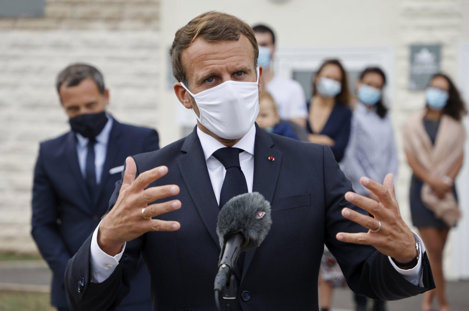 French President Emmanuel Macron speaks in Longjumeau, a southern suburb of Paris, Sept. 23, 2020. (AP Photo)