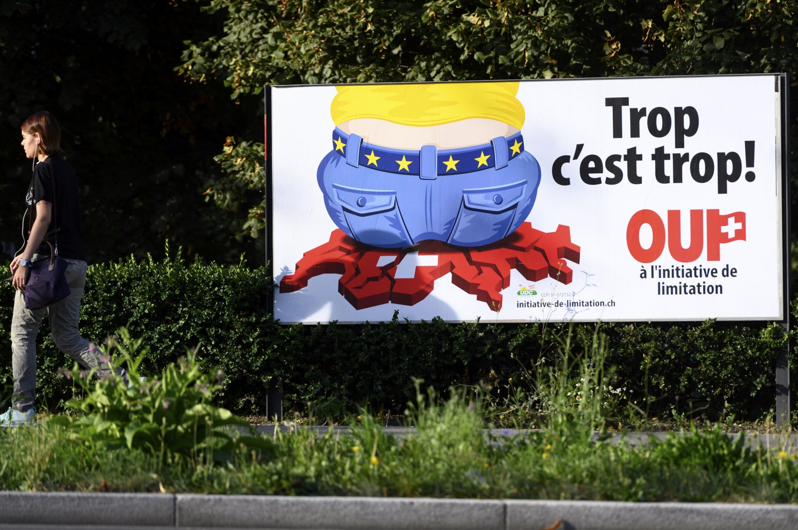 A poster of the Swiss People's Party (SVP) for a moderate immigration initiative reading ''Enough is enough!'' is displayed in a street in Lausanne, Switzerland, Aug. 27, 2020. (AP File Photo)