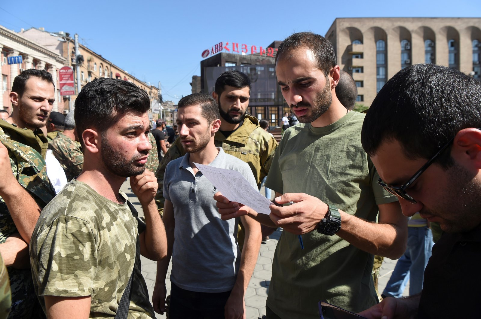 People attend a meeting to recruit military volunteers after Armenian authorities declared martial law and mobilized its male population following clashes with Azerbaijan over the breakaway Nagorno-Karabakh region in Yerevan, Armenia, Sept. 27, 2020. (REUTERS)