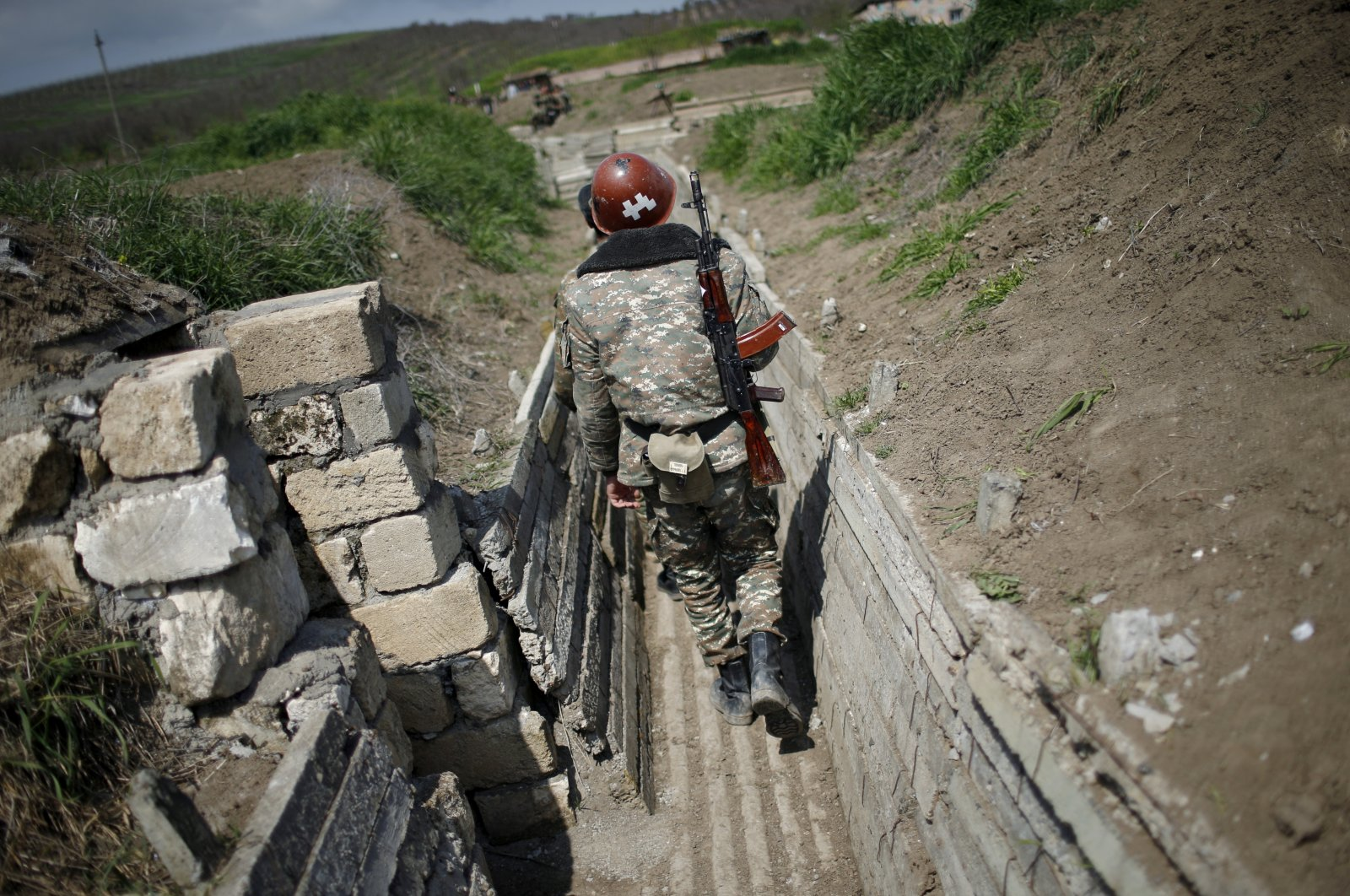 Armenian soldiers walk in a trench at their position near Nagorno-Karabakh's boundary, April 8, 2016. (Reuters File Photo)