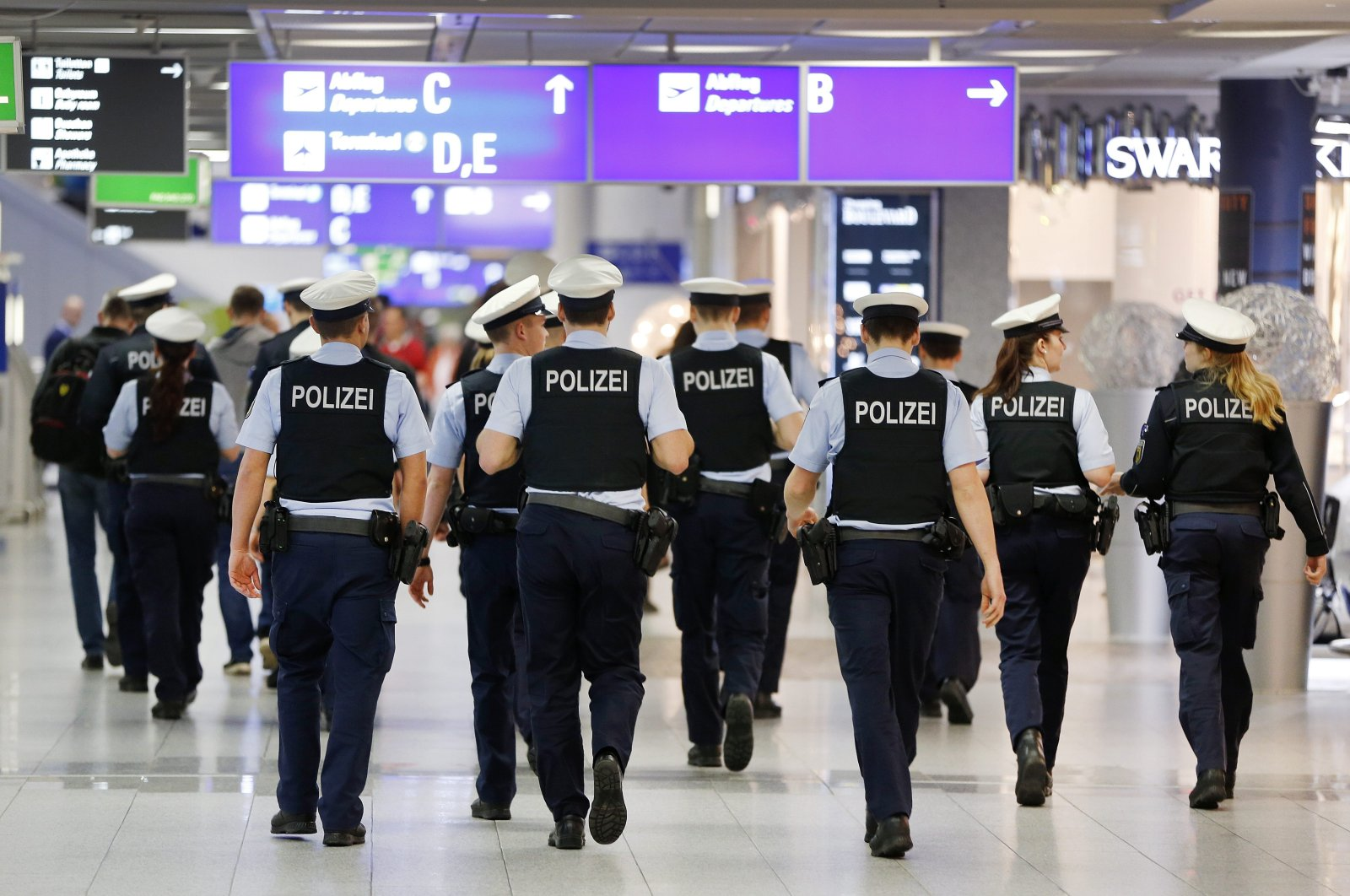 German police officers walk in a terminal at the airport, Frankfurt, Germany, March 23, 2016. (AP Photo)