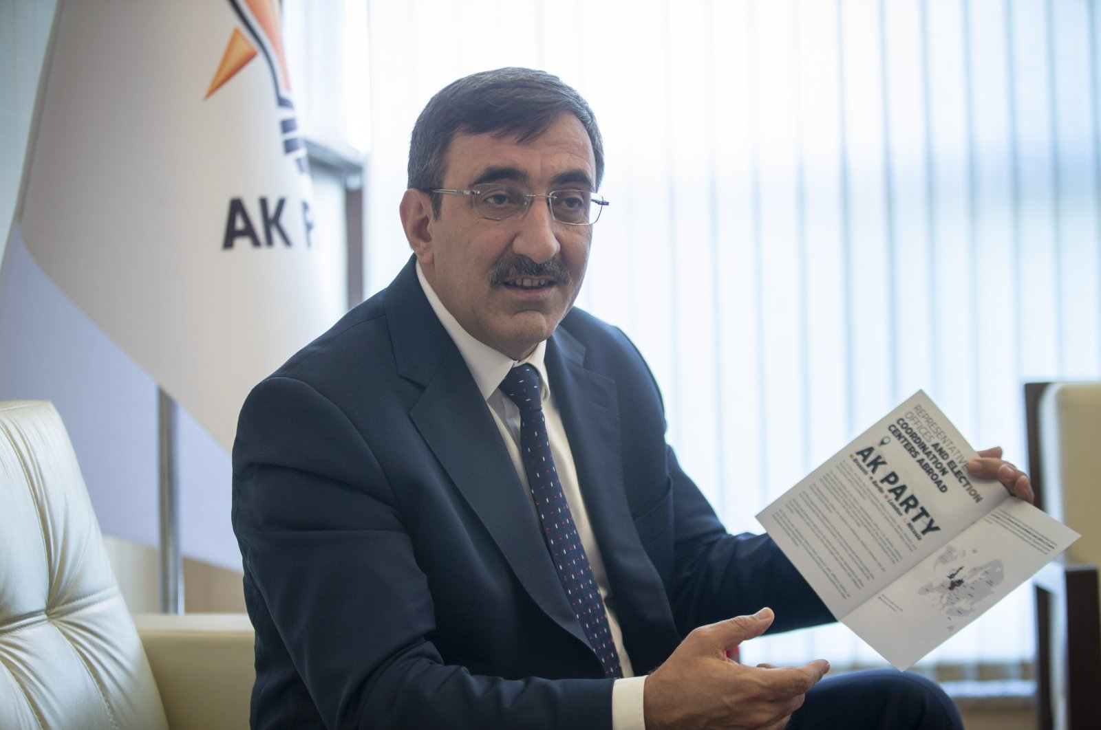 The ruling Justice and Development Party (AK Party) Deputy Chair Cevdet Yılmaz explains about the booklets prepared by the party, Sept. 28, 2020. (AA Photo)