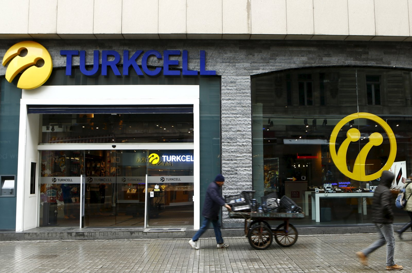 Pedestrians walk past by the main Turkcell shop in central Istanbul, Turkey, Jan. 18, 2016. (Reuters Photo)