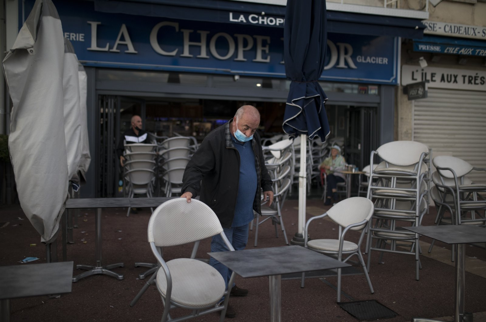 A man closes his restaurant in Marseille, southern France, Sept. 27, 2020. (AP Photo)