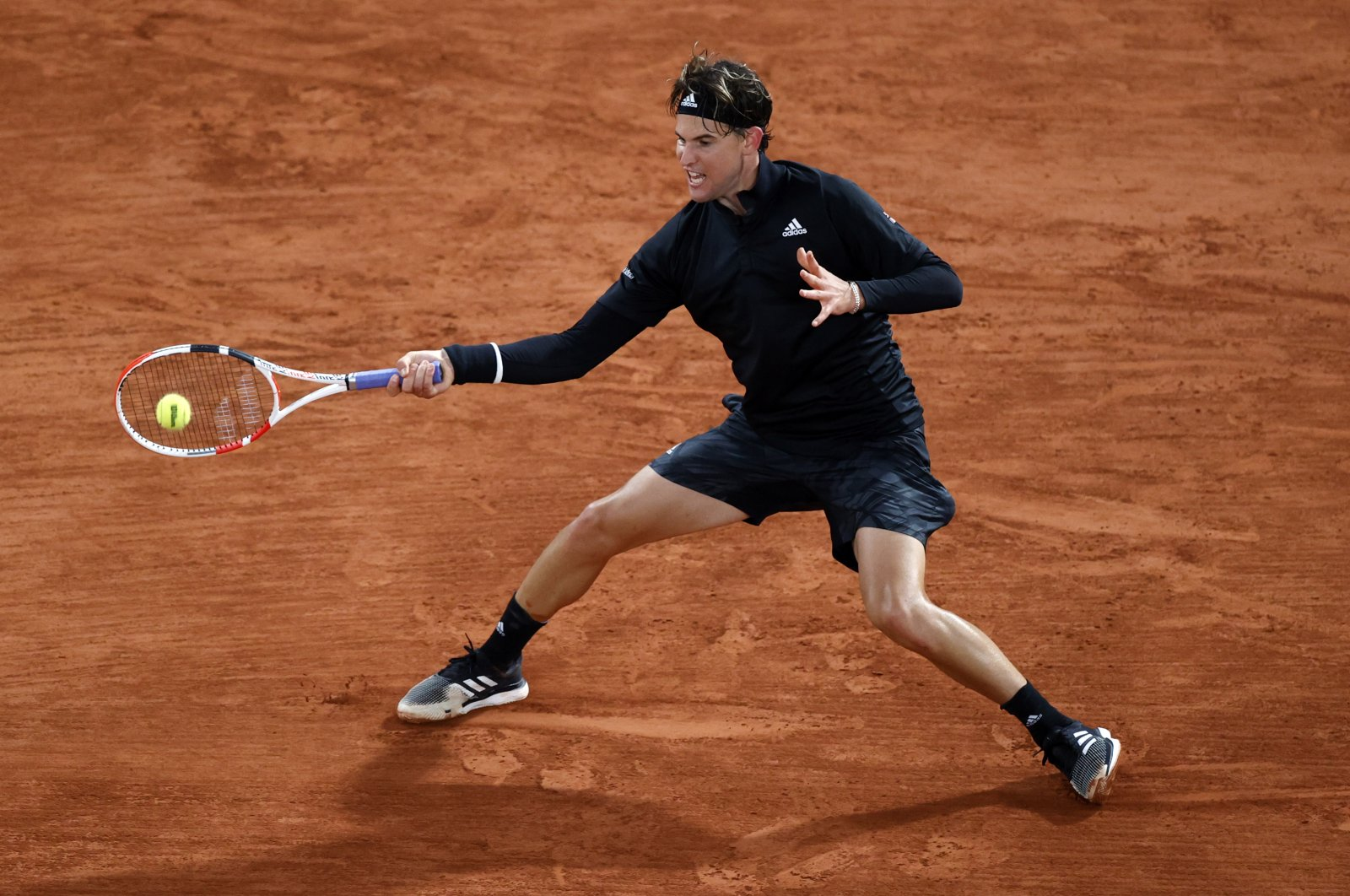 Dominic Thiem in action during the French Open first-round match against Marin Cilic, in Paris, France, Sept. 28, 2020. (Reuters Photo)