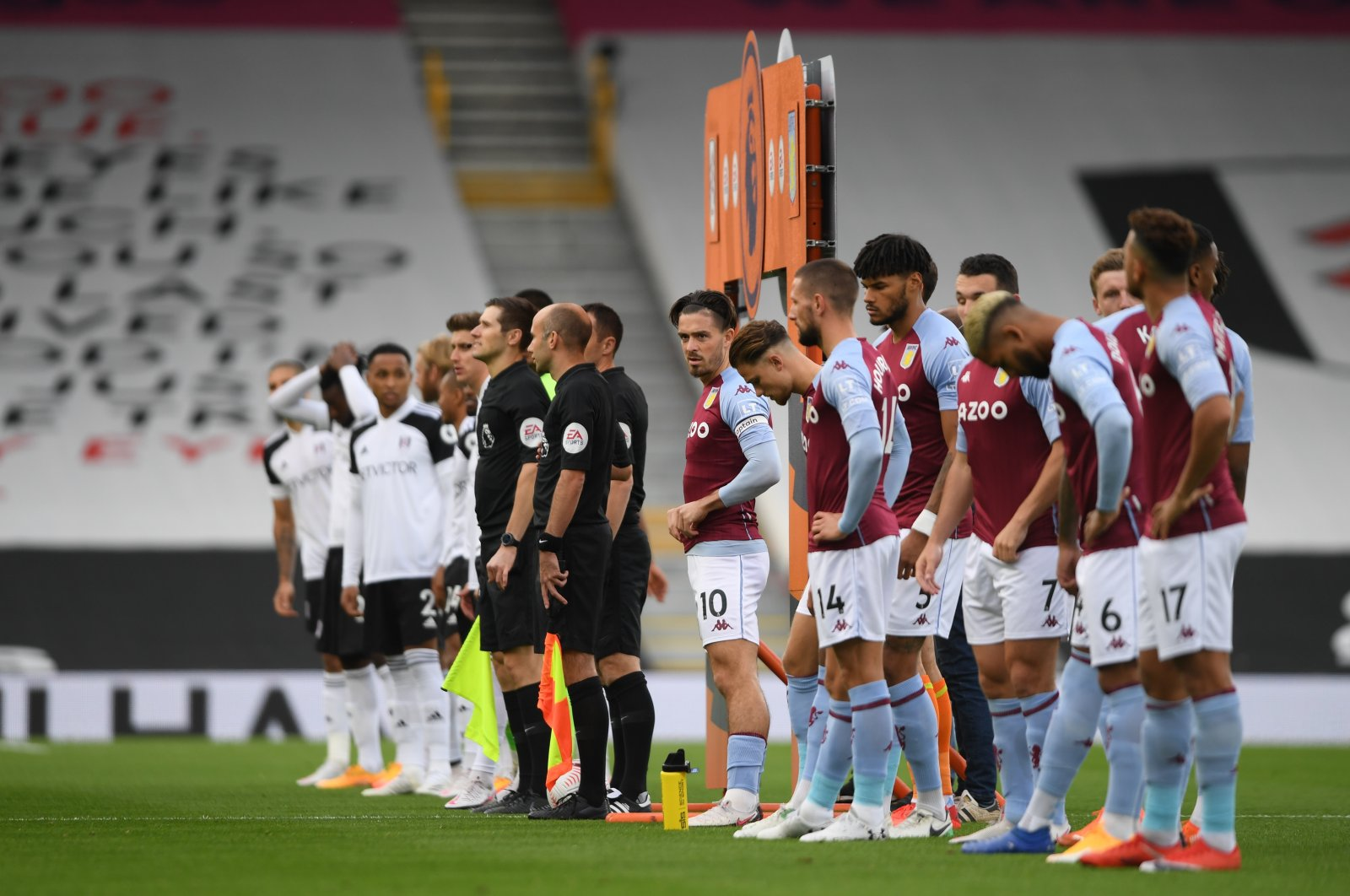 Teams line up before a Premier League match between Fulham and Aston Villa in Craven Cottage, London, Britain, Sept. 28, 2020. (Pool via Reuters)