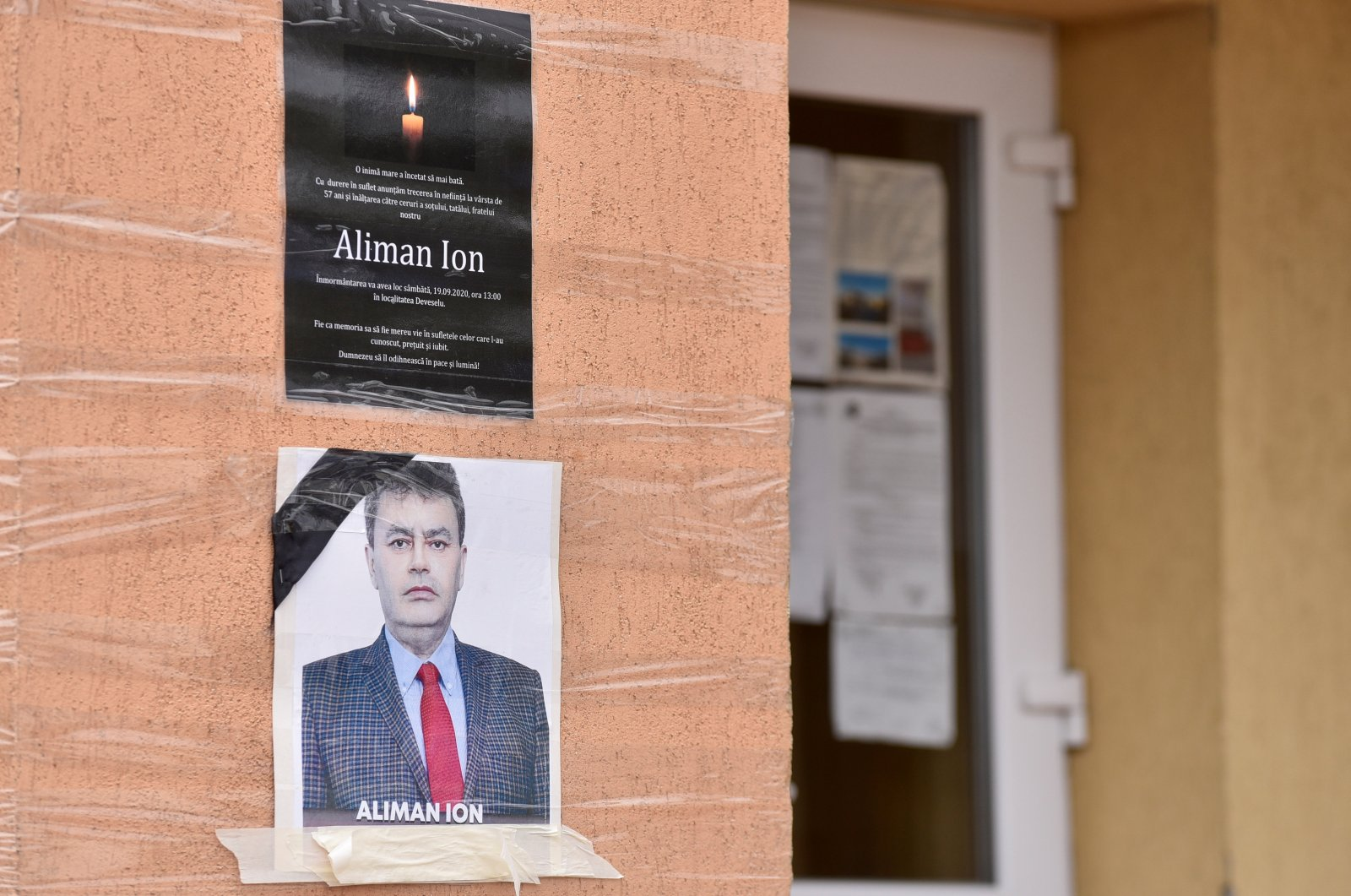 An obituary photo of former mayor Aliman Ion is taped onto the walls of the city hall in Deveselu, Romania, Sept. 28, 2020. (Reuters Photo)