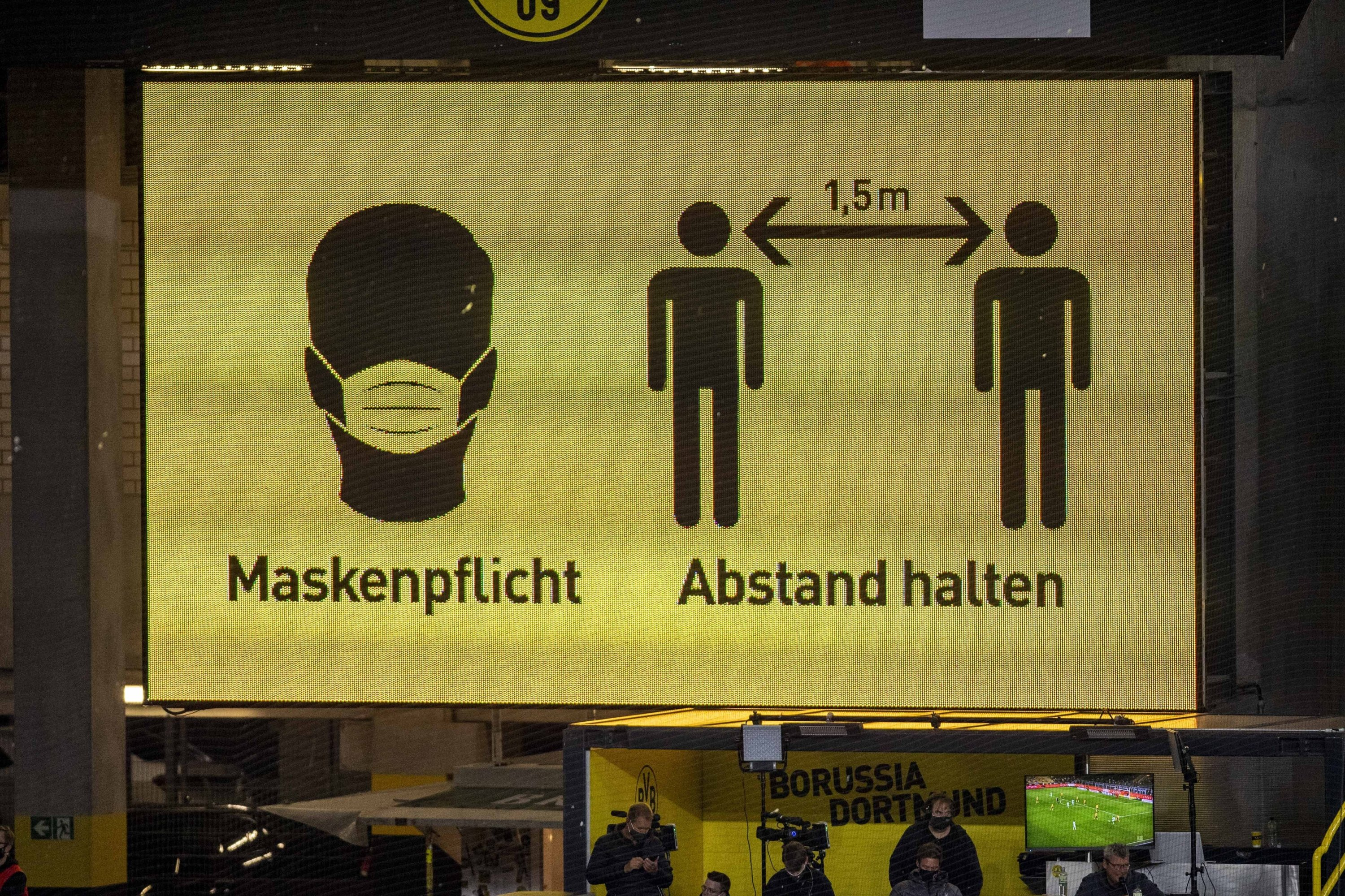 The scoreboard at Signal Iduna Park in Dortmund Nordrhein Westfalen indicates that masks are compulsory and that you must keep your distance, Sept. 19, 2020. (via REUTERS)