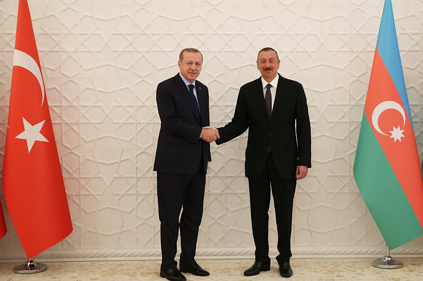 President Recep Tayyip Erdoğan and Azerbaijani President Ilham Aliyev shake hands following a meeting at the Presidential Complex in Ankara, Turkey, Feb. 12, 2020. (Presidency handout)